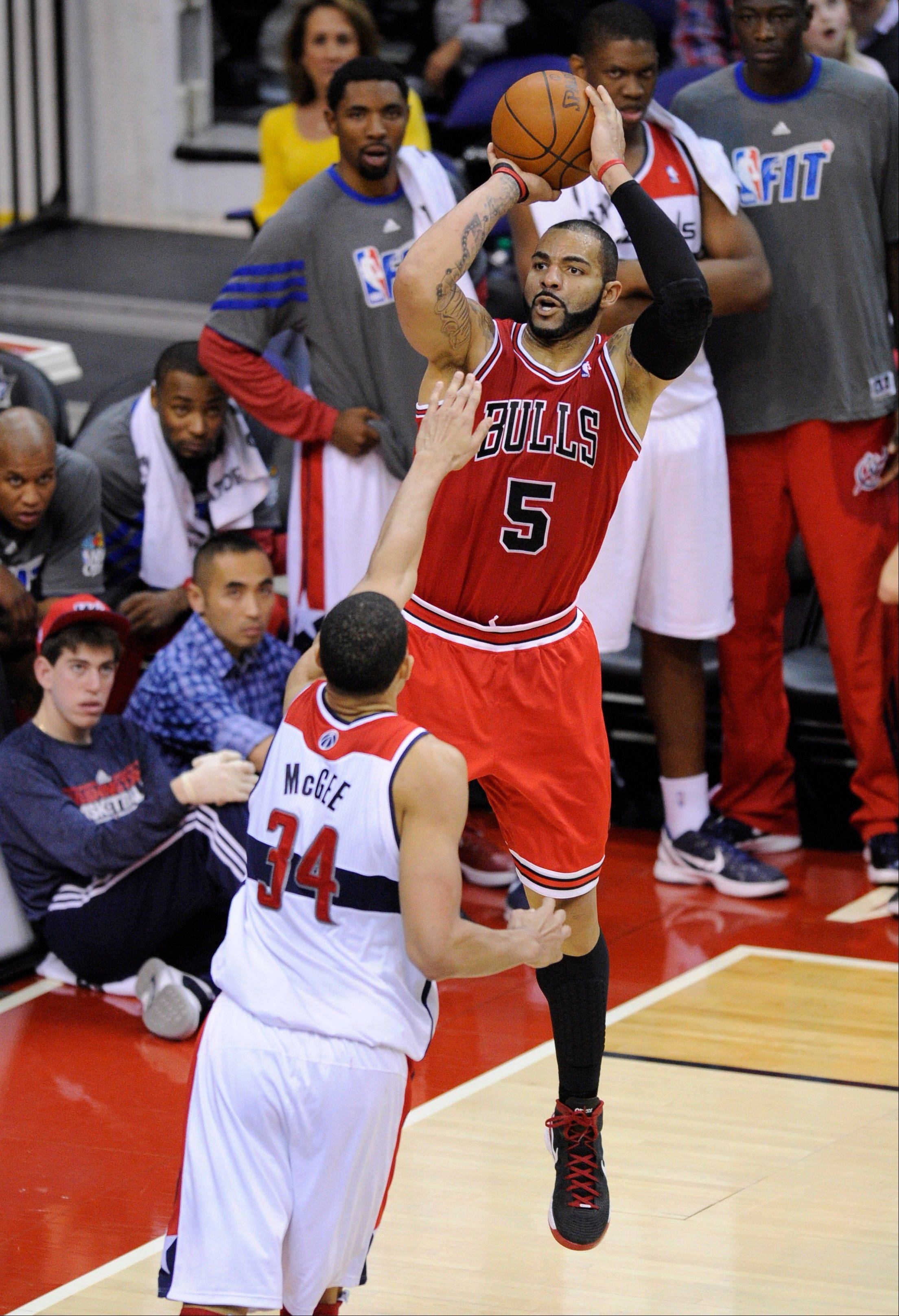 Chicago Bulls forward Carlos Boozer (5) shoots against Washington Wizards center JaVale McGee (34) during the second half of a game Monday in Washington. The Bulls won 98-88.
