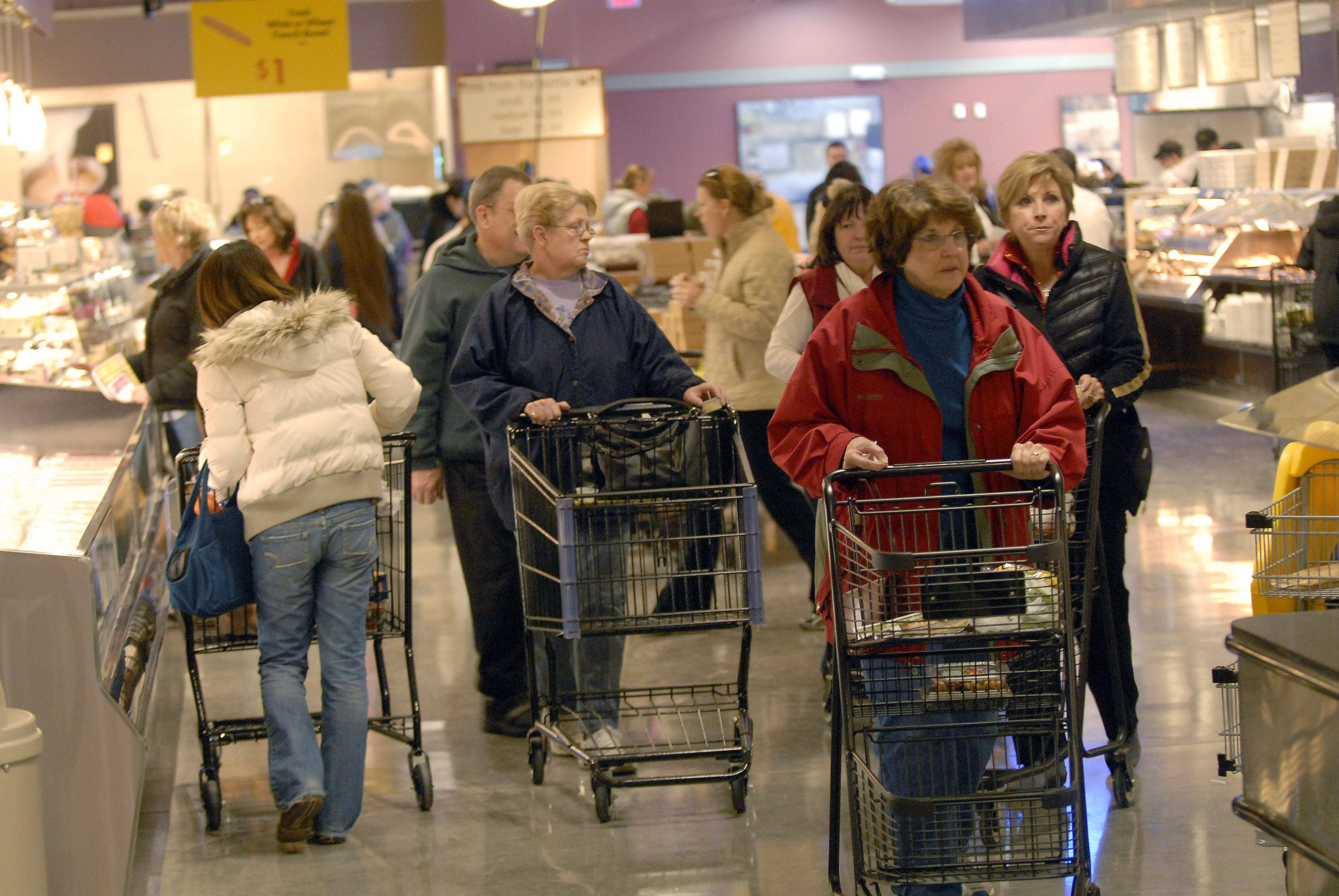 Shoppers crowd the aisles as they check out the new Mariano's Fresh Market Tuesday in Palatine. This was the grand opening of the third Northwest suburban store in addition to Mariano's two Chicago stores.