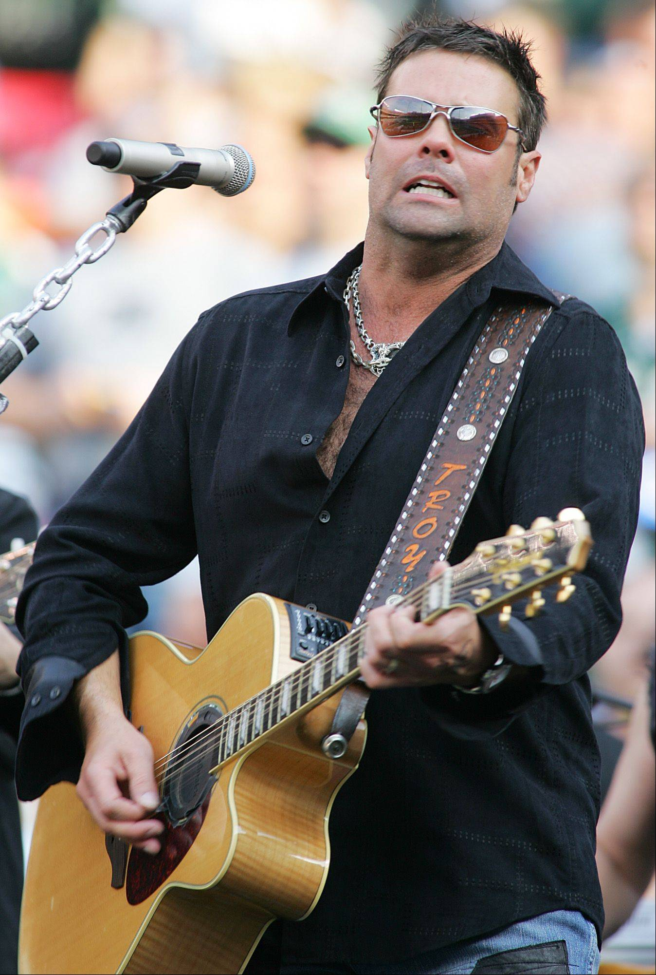Troy Gentry of the country western group Montgomery Gentry performs at the tail end of the Professional Championship Bullriders: World Tour Finale VI at the Sears Centre Arena in Hoffman Estates.