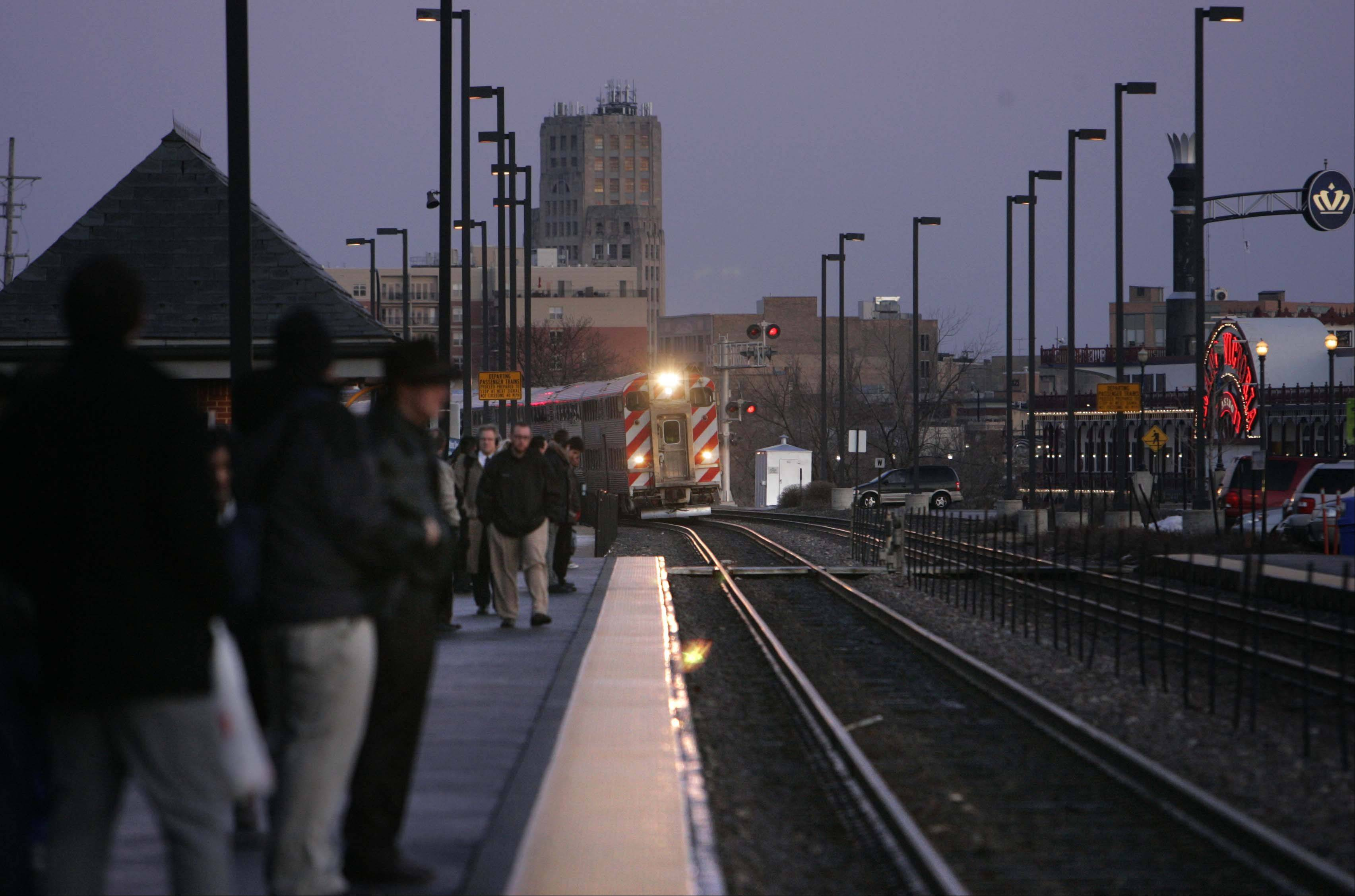 A Metra train rolls into Elgin Tuesday, the day before fares spike by 30 percent for 10-ride tickets and 29 percent for monthly passes. Officials say rising costs and past financial mismanagement have made the hikes necessary, but many commuters are unhappy with the added expense.