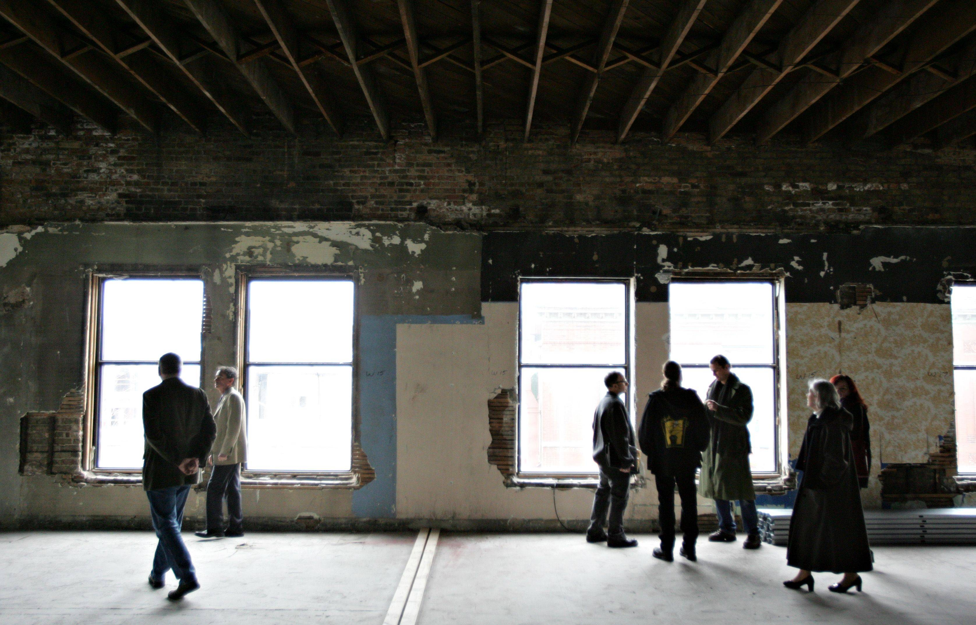 Community members and prospective renters gathered Tuesday to tour the progress of the Artspace project as part of the Downtown Neighborhood Association's January Out to Lunch event. Construction is expected to finish in October.