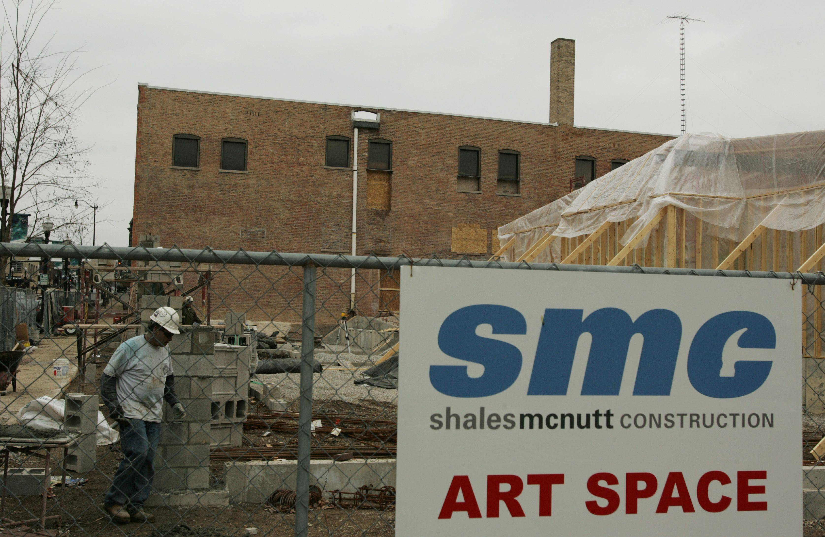 Besides renovating the former Elgin Community College Fountain Square campus, Shales McNutt Construction workers are putting up a new, adjacent building to fit more of the 55 rental units planned for the project.