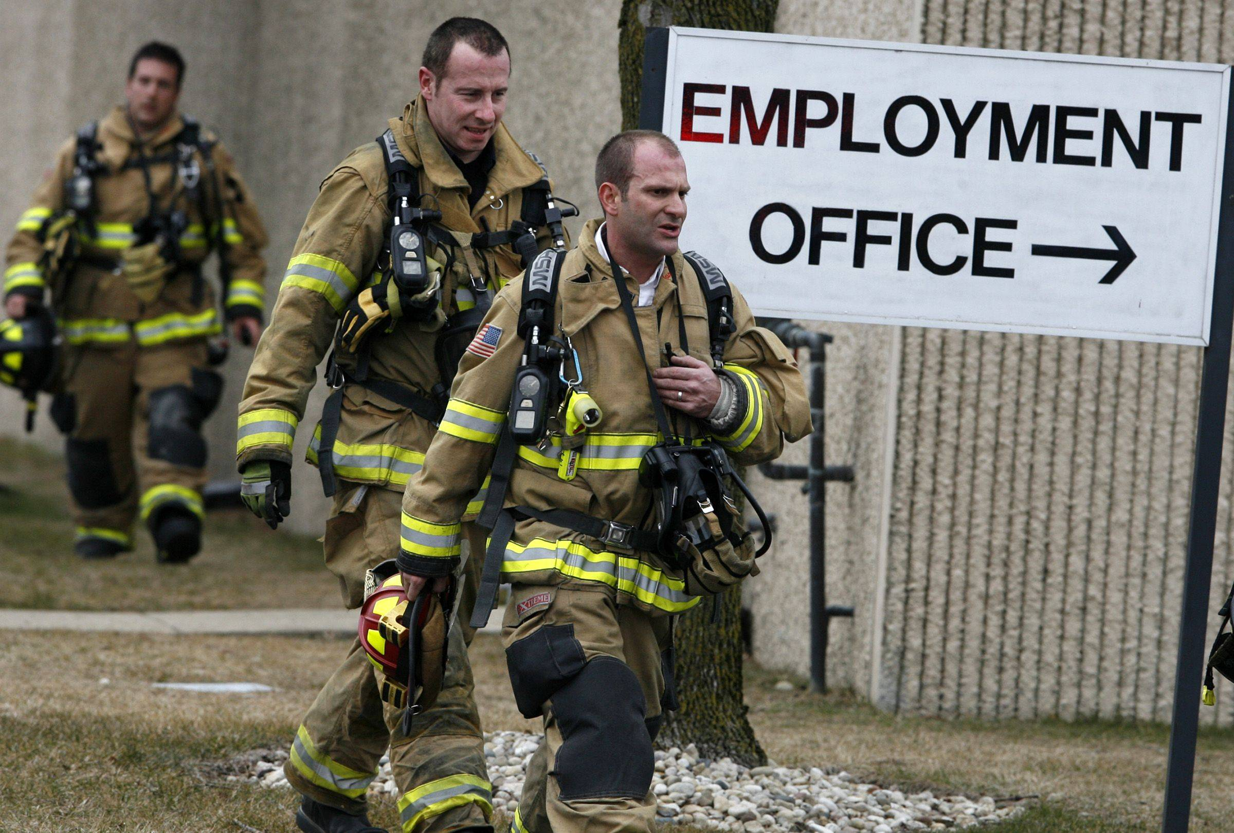 Firefighters exit Durable Packaging International in Wheeling Tuesday while evacuating the facility after an apparent carbon monoxide leak left several employees ill.