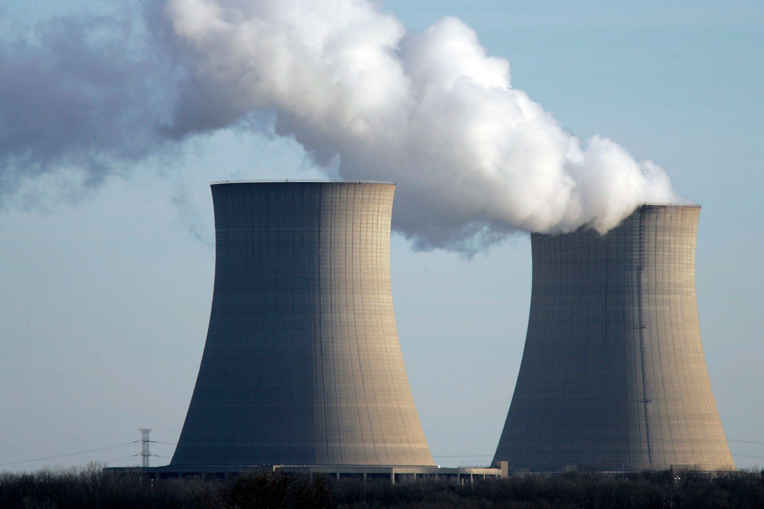 Steam rises from one of the two cooling towers Monday at the Byron nuclear generating station in Ogle County, Ill. A loss of power coming into the plant caused one of the reactors to automatically shutdown Monday morning.