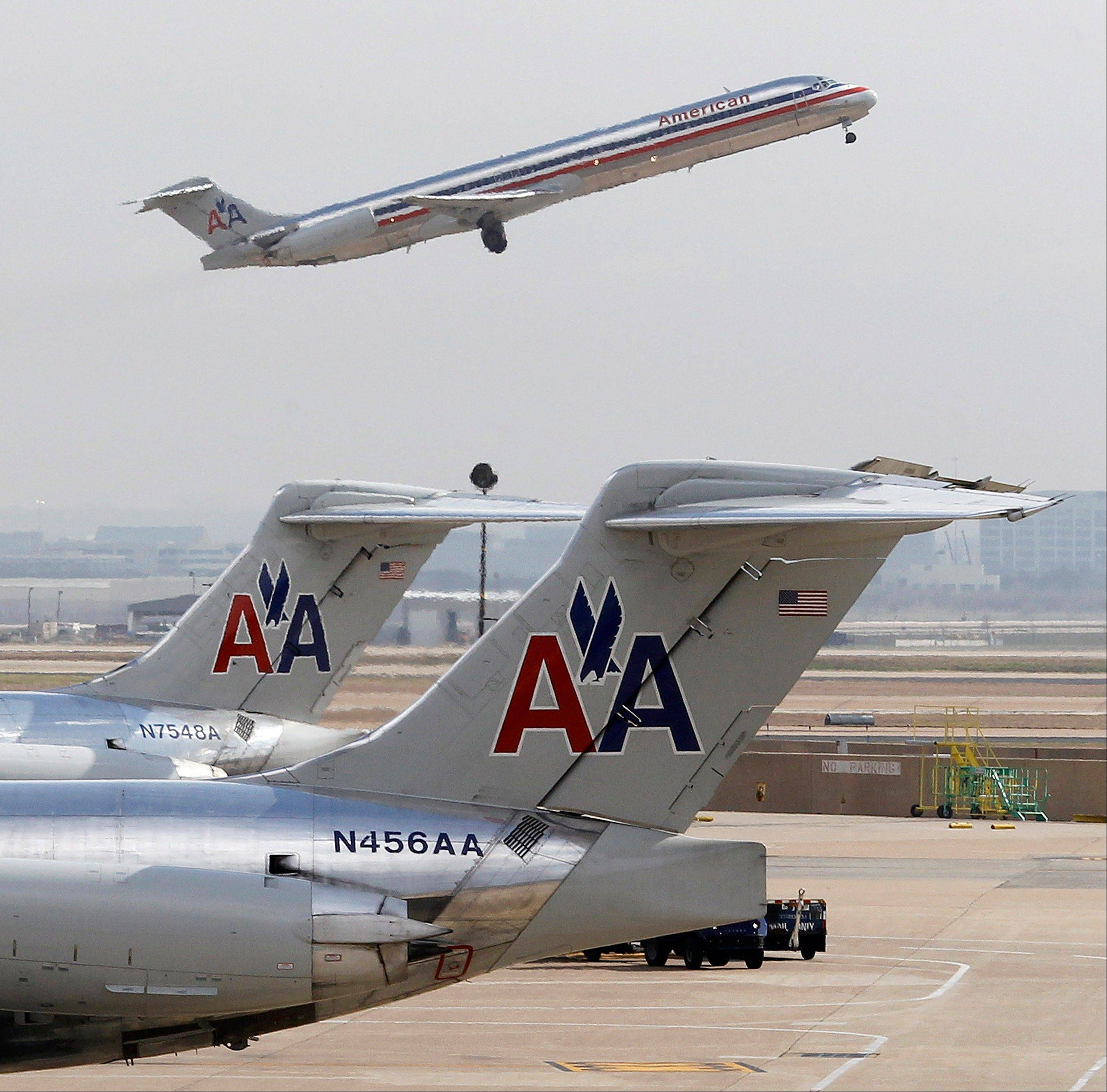 American Airlines' parent company says it lost $904 million in December.