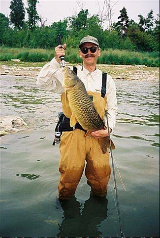 Paul Melchior, here with a river carp caught with his fly rod, has lots of advice at his website, anglingescapes.com.