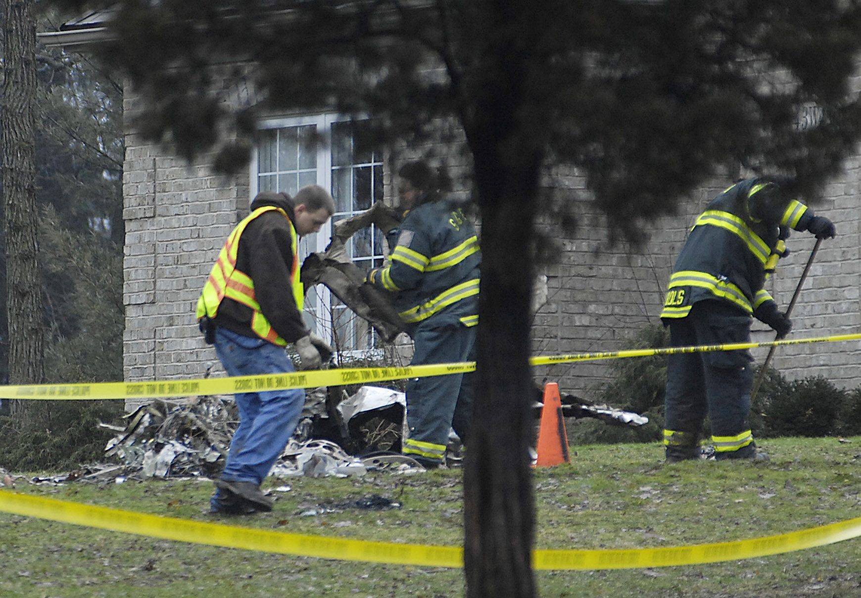 Pieces of wreckage are gathered from a yard at Old Oaks Road near Route 47 in Sugar Grove following a plane crash in January 2010. The pilot and his passenger were killed in the crash. The homeowners have sued the pilot's estate and his Florida employer, which owned the plane.