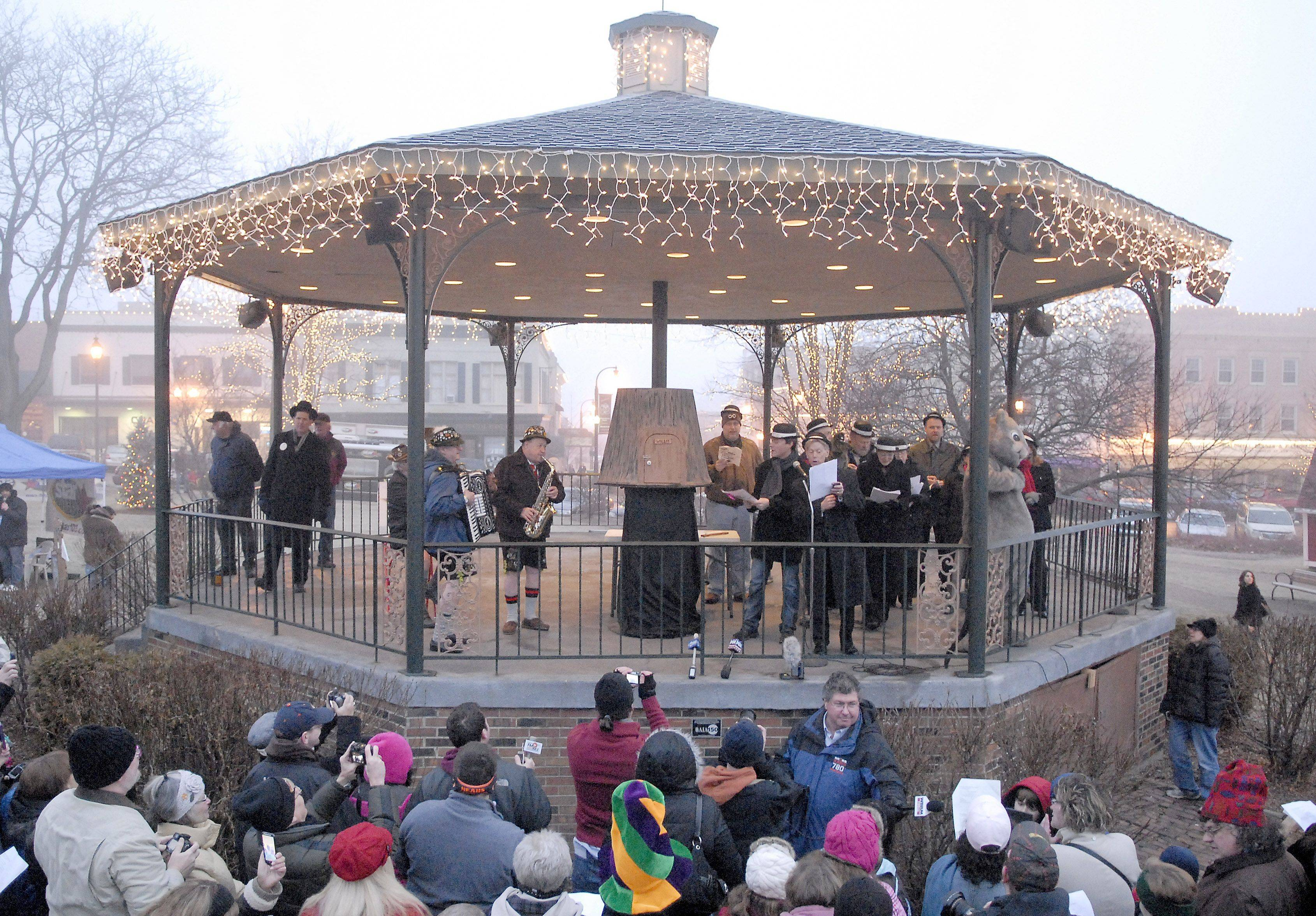 Woodstock Mayor Brian Sager leads songs about the groundhog before Woodstock Willie makes an appearance at the crack of dawn on Thursday -- Groundhog Day.