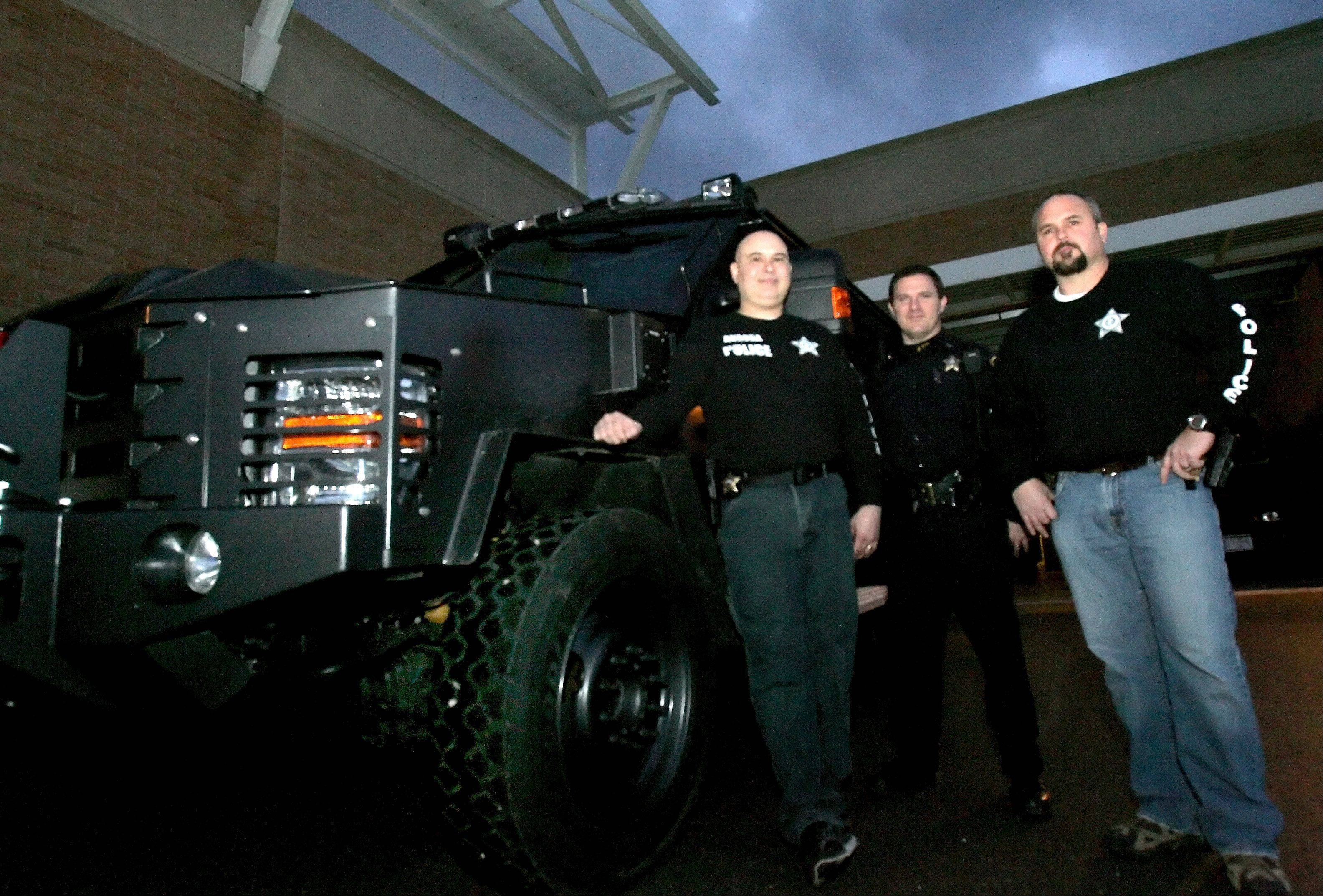 Aurora police sergeants Alfredo Dean, Joe Weber and Ricky Ahlgren used the massive Special Response Team armored vehicle sometimes called 'the tank' to help motorists stranded during the Blizzard of 2011.