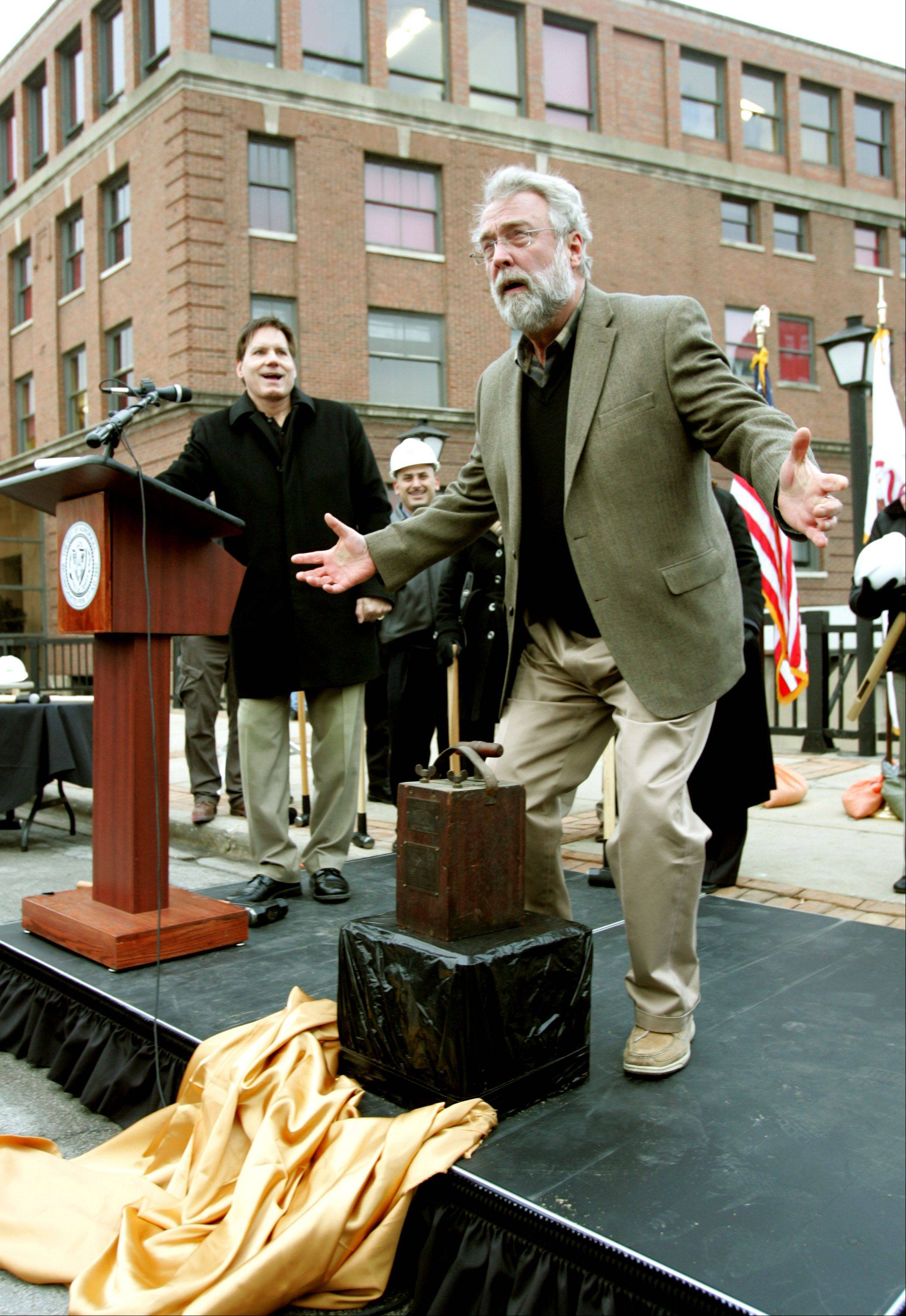 "Aurora Mayor Tom Weisner marks the beginning of the replacement of the two Downer Place Bridges downtown with a ""Last Blast on the Bridge"" ceremony Friday afternoon. A brief fireworks display, however, provided the only real blast at the event. Bridge demolition is set to begin Monday."