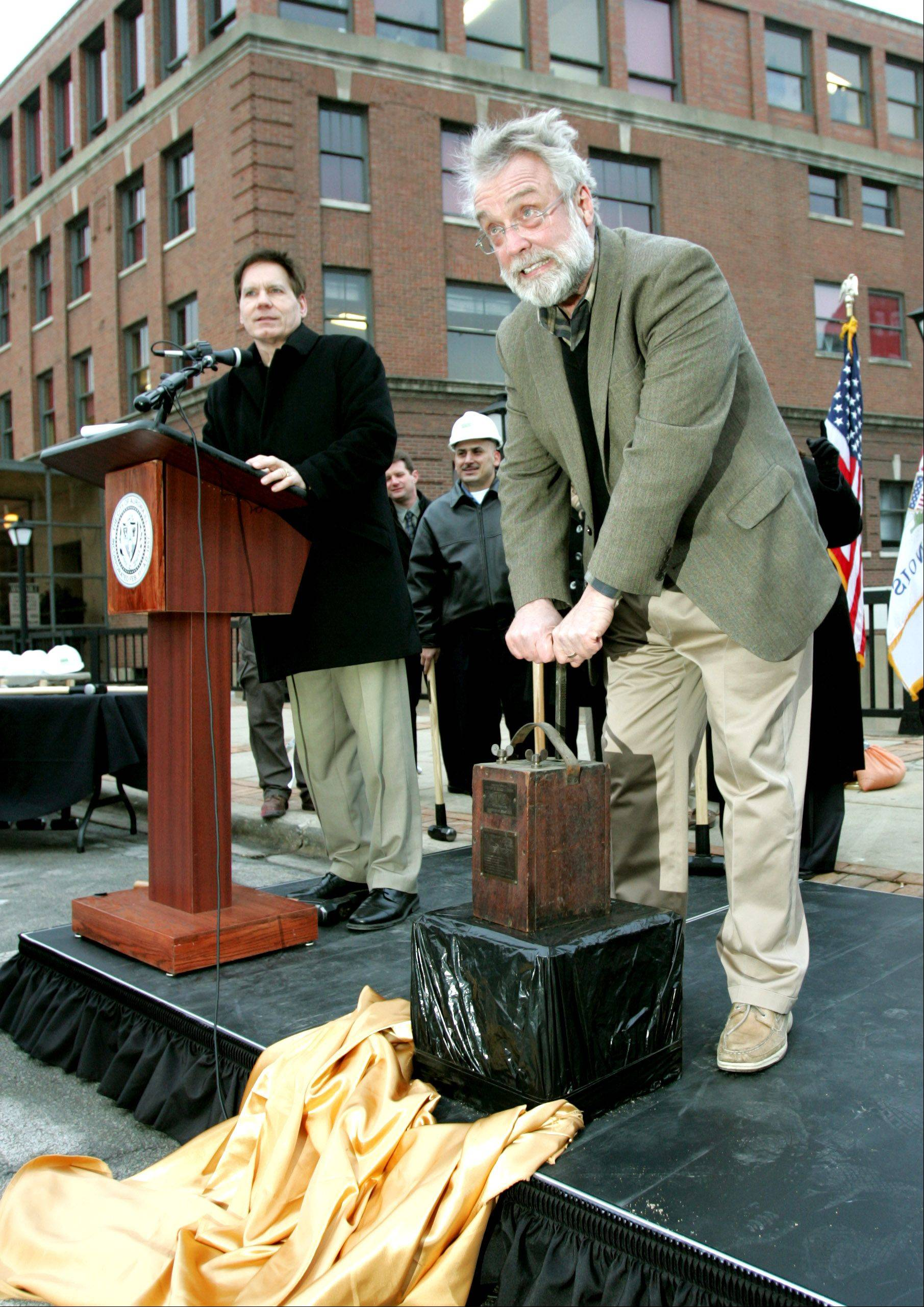 "Replacement of the century-old Downer Place gets started Friday afternoon with a ""Last Blast on the Bridge"" ceremony. Aurora Mayor Tom Weisner ignites the charge, which lit a short fireworks display, but not a bridge explosion."
