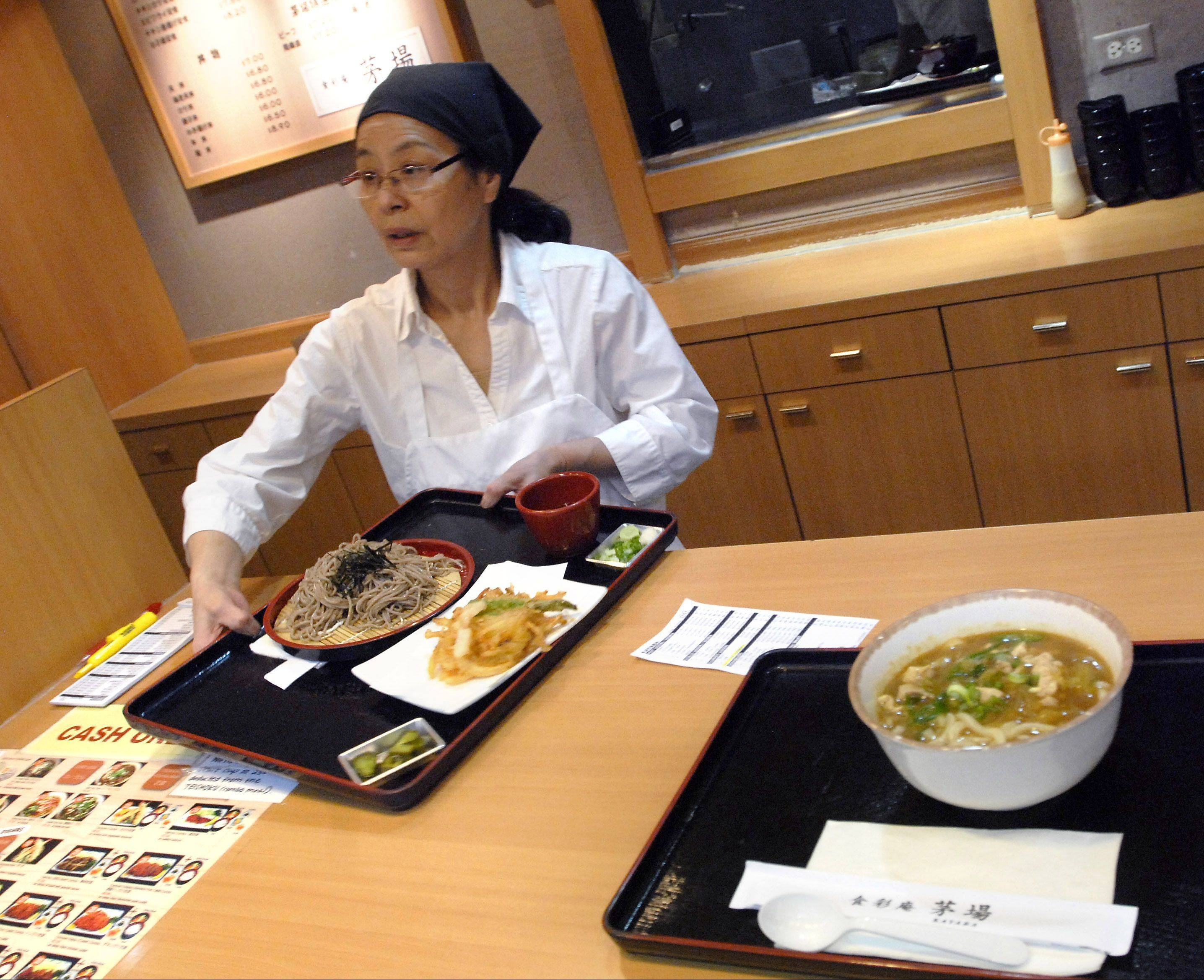 Kinuko Nishikata of Mount Prospect serves up noodles, tempura and soups at Kayaba restaurant in the food court at Mitsuwa Marketplace.