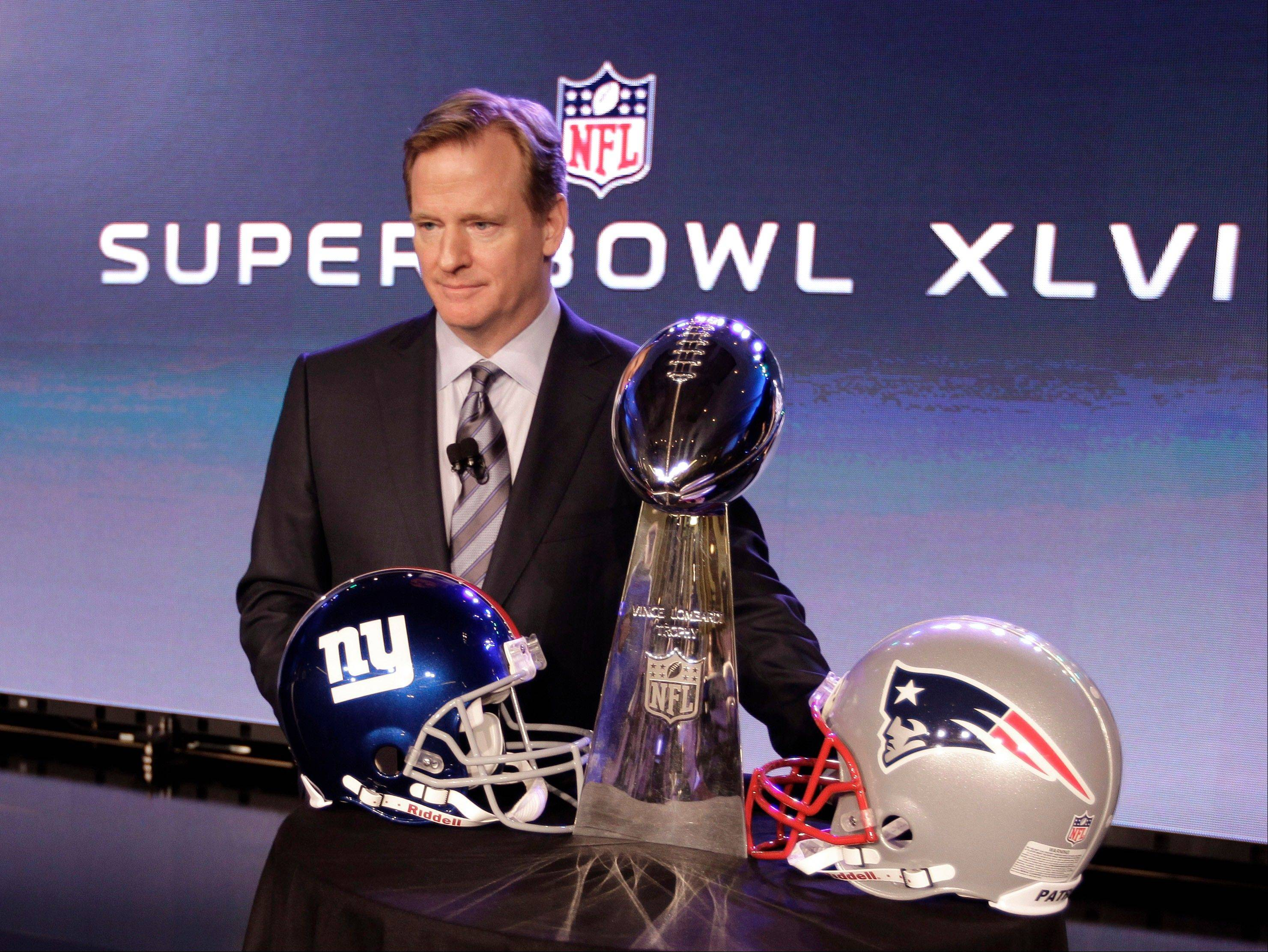 NFL Commissioner Roger Goodell poses with the Vince Lombardi Trophy after a news conference Friday, Feb. 3, 2012, in Indianapolis. The New England Patriots will face the New York Giants in Super Bowl XLVI on Feb. 5.