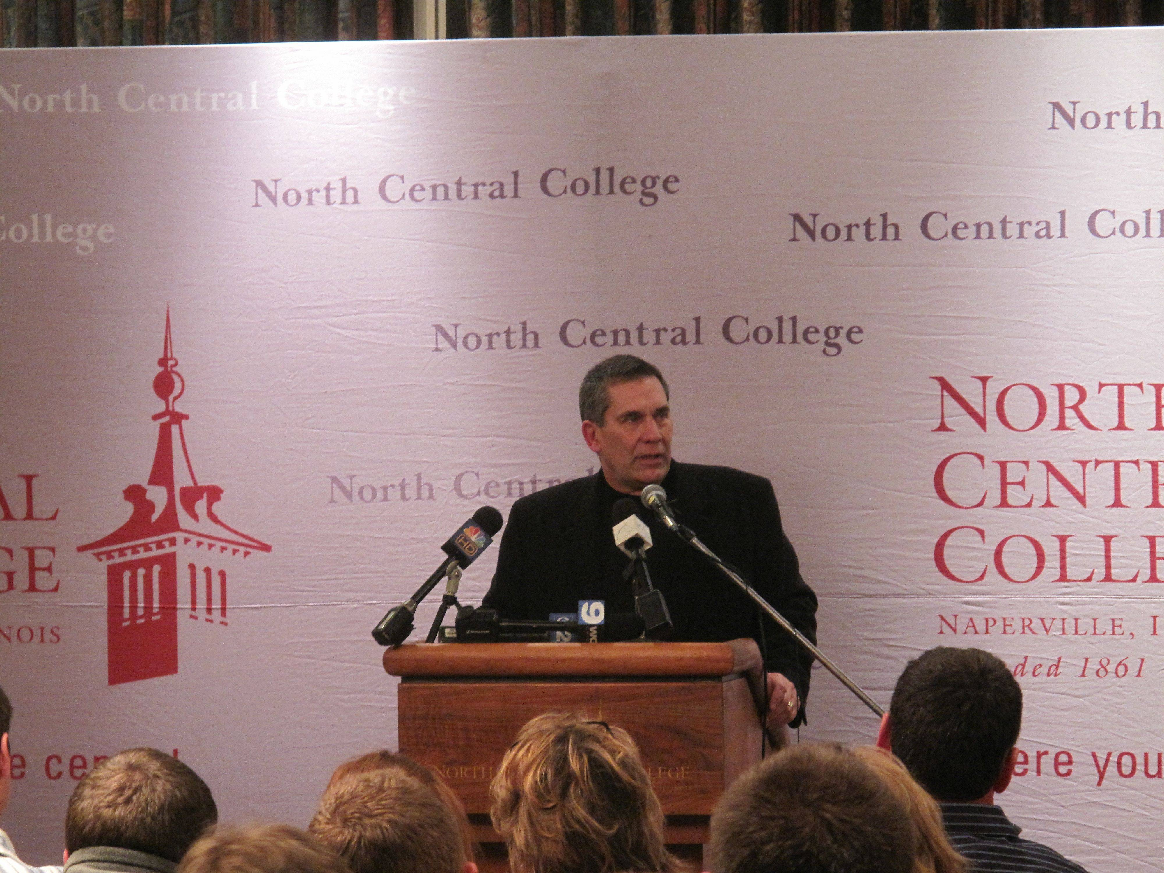 Head Football Coach John Thorne talks about Shaun Wild at a community gathering Saturday night at North Central College.