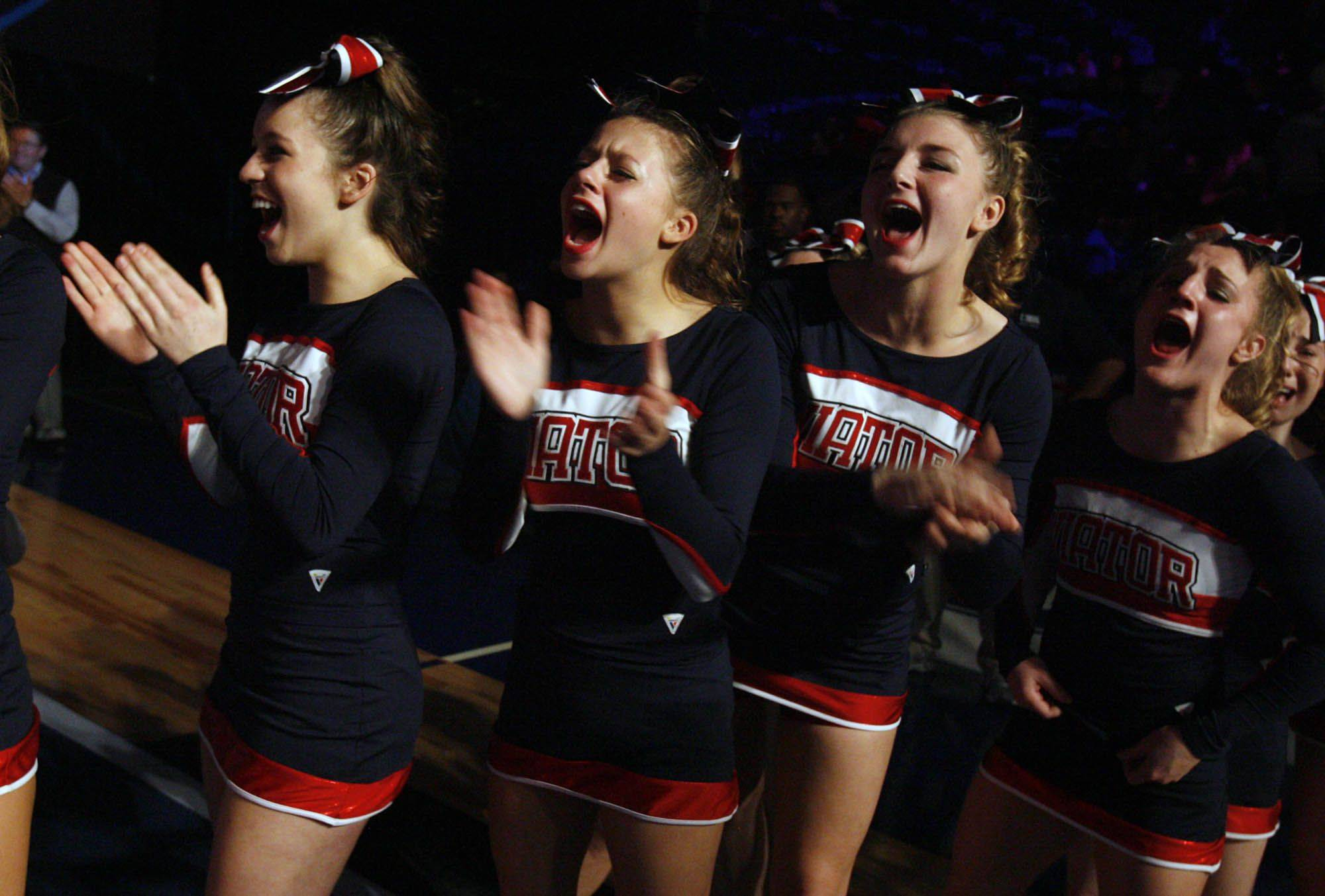 St. Viator High School cheerleading team celebrate taking first place at IHSA cheerleading state finals for the medium school category at U.S. Cellular Coliseum in Bloomington on Saturday.
