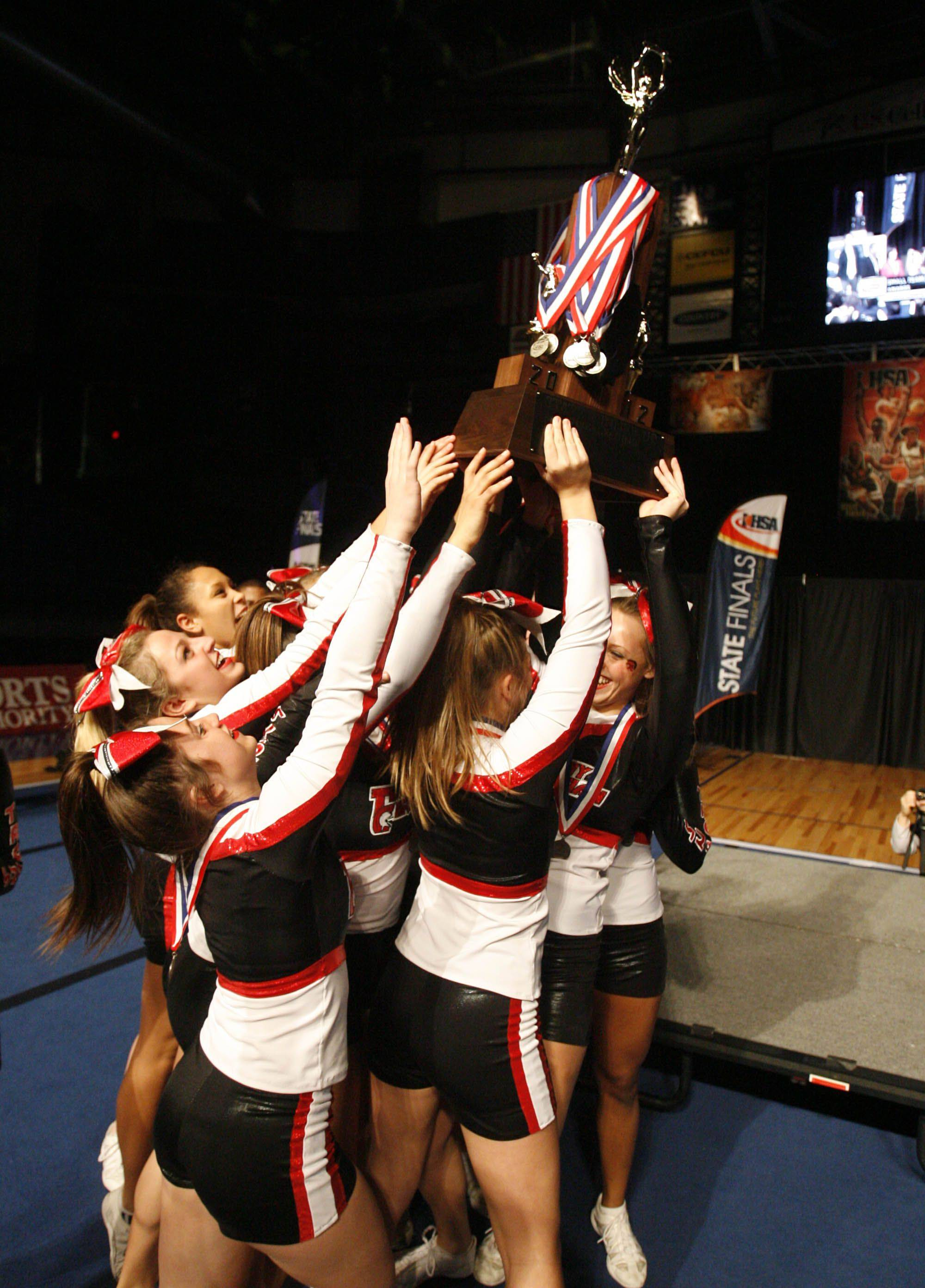 Timothy Christian raises the second place trophy at IHSA cheerleading state finals for the small school category at U.S. Cellular Coliseum in Bloomington on Saturday.