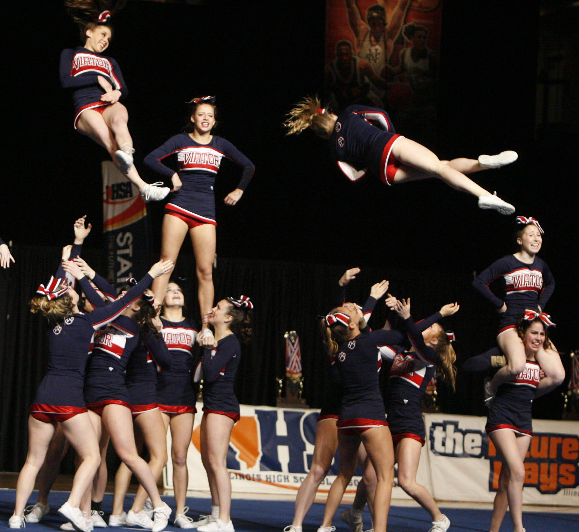 St. Viator competes in the medium team category at IHSA cheerleading state finals at U.S. Cellular Coliseum in Bloomington on Saturday.