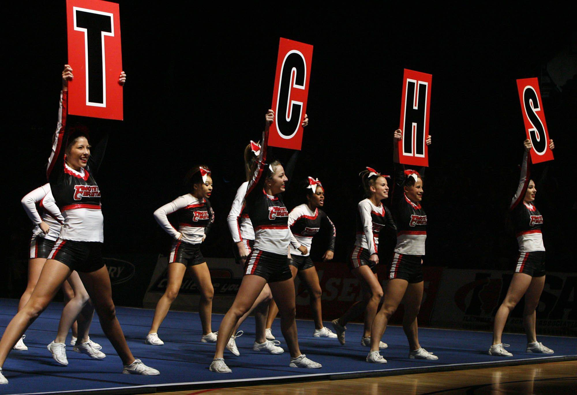 Timothy Christian competes in the small team category at IHSA cheerleading state finals at U.S. Cellular Coliseum in Bloomington on Saturday.