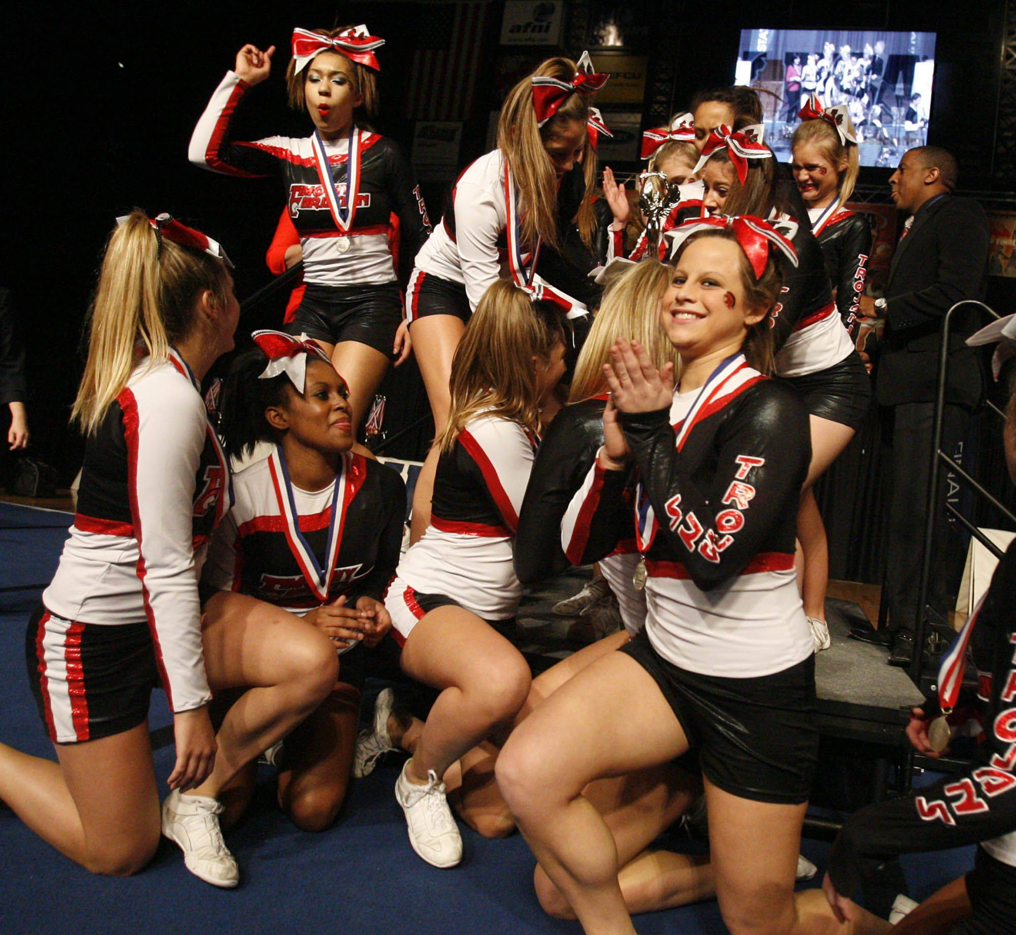 Timothy Christian celebrate taking second place at IHSA cheerleading state finals for the small school category at U.S. Cellular Coliseum in Bloomington on Saturday.