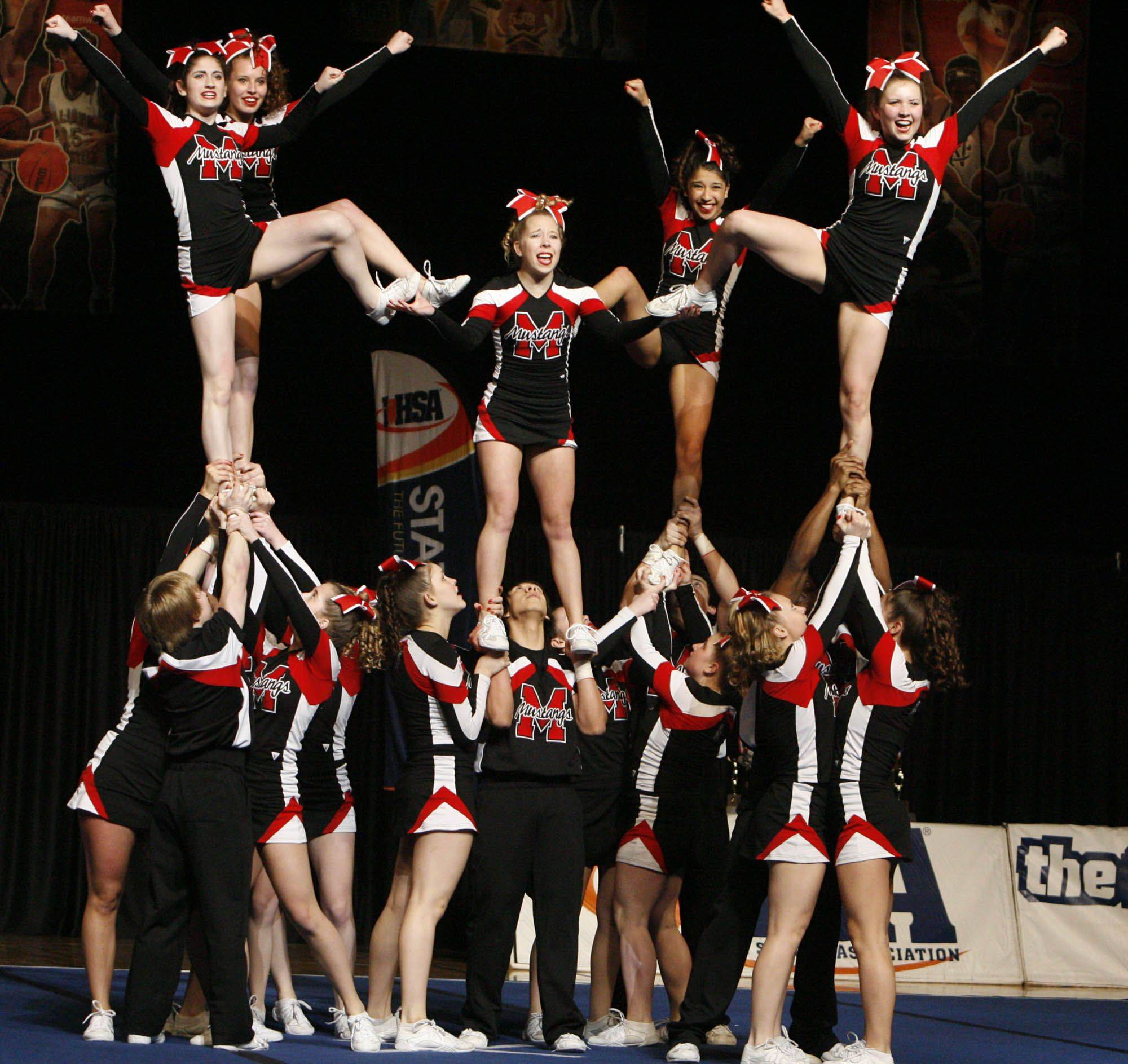 Mundelein performs at IHSA cheerleading state finals at U.S. Cellular Coliseum in Bloomington on Saturday, February 4th.