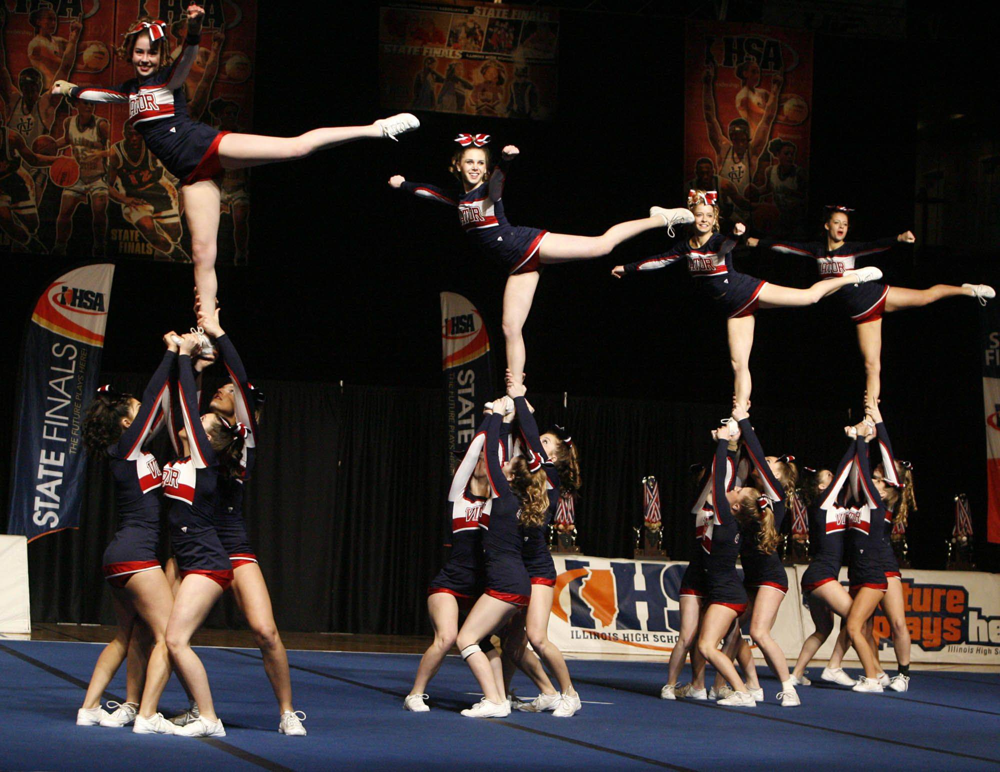 St. Viator competes in the medium team category at IHSA cheerleading state finals at U.S. Cellular Coliseum in Bloomington on Saturday, February 4th.