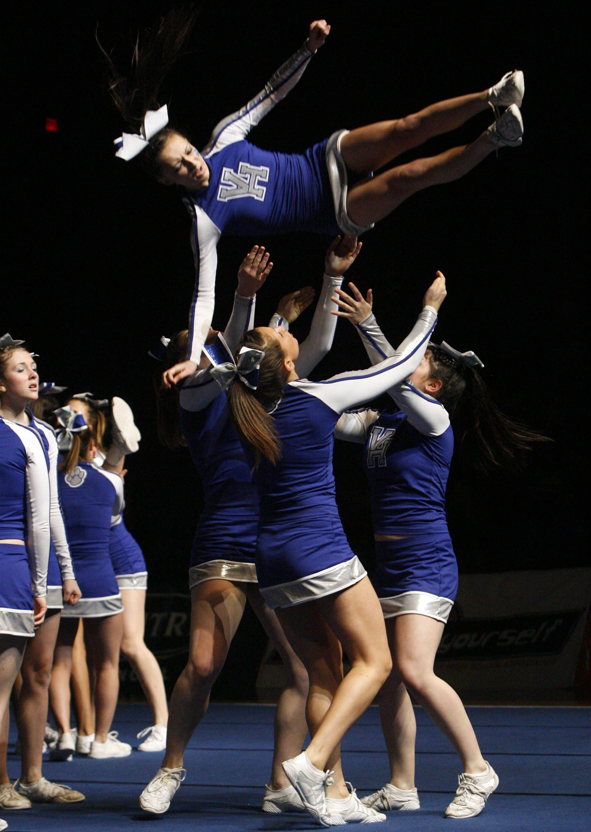 Vernon Hills compete in the medium team category at IHSA cheerleading state finals at U.S. Cellular Coliseum in Bloomington on Saturday, February 4th.