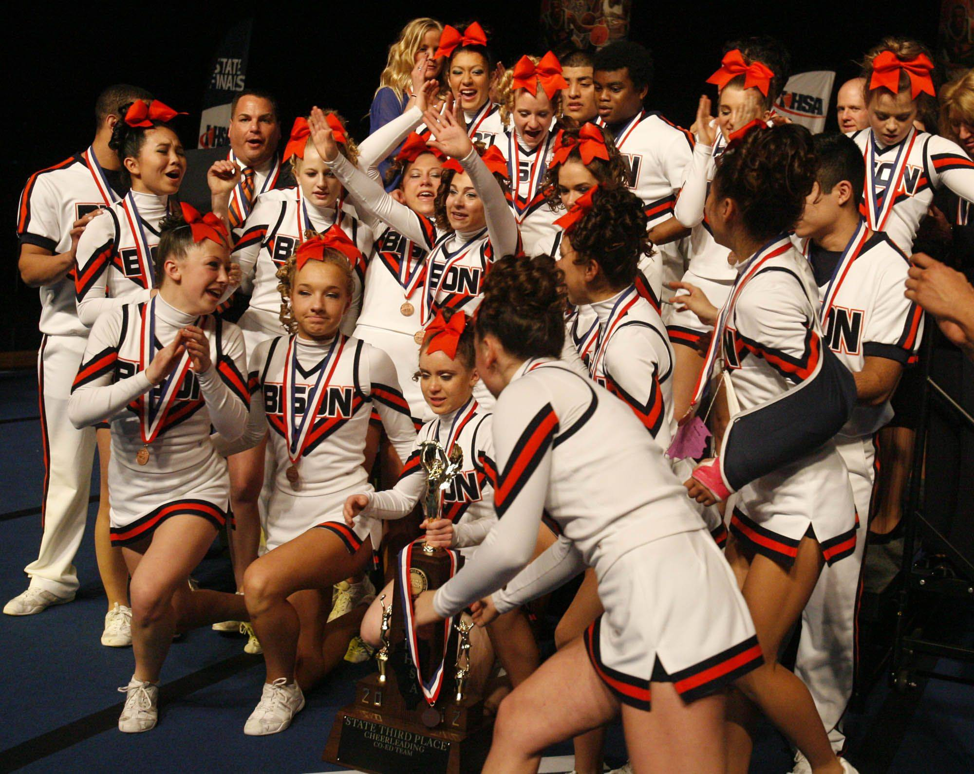 Buffalo Grove celebrates with the 3rd place trophy for coed division at IHSA cheerleading state finals at U.S. Cellular Coliseum in Bloomington on Saturday, February 4th.