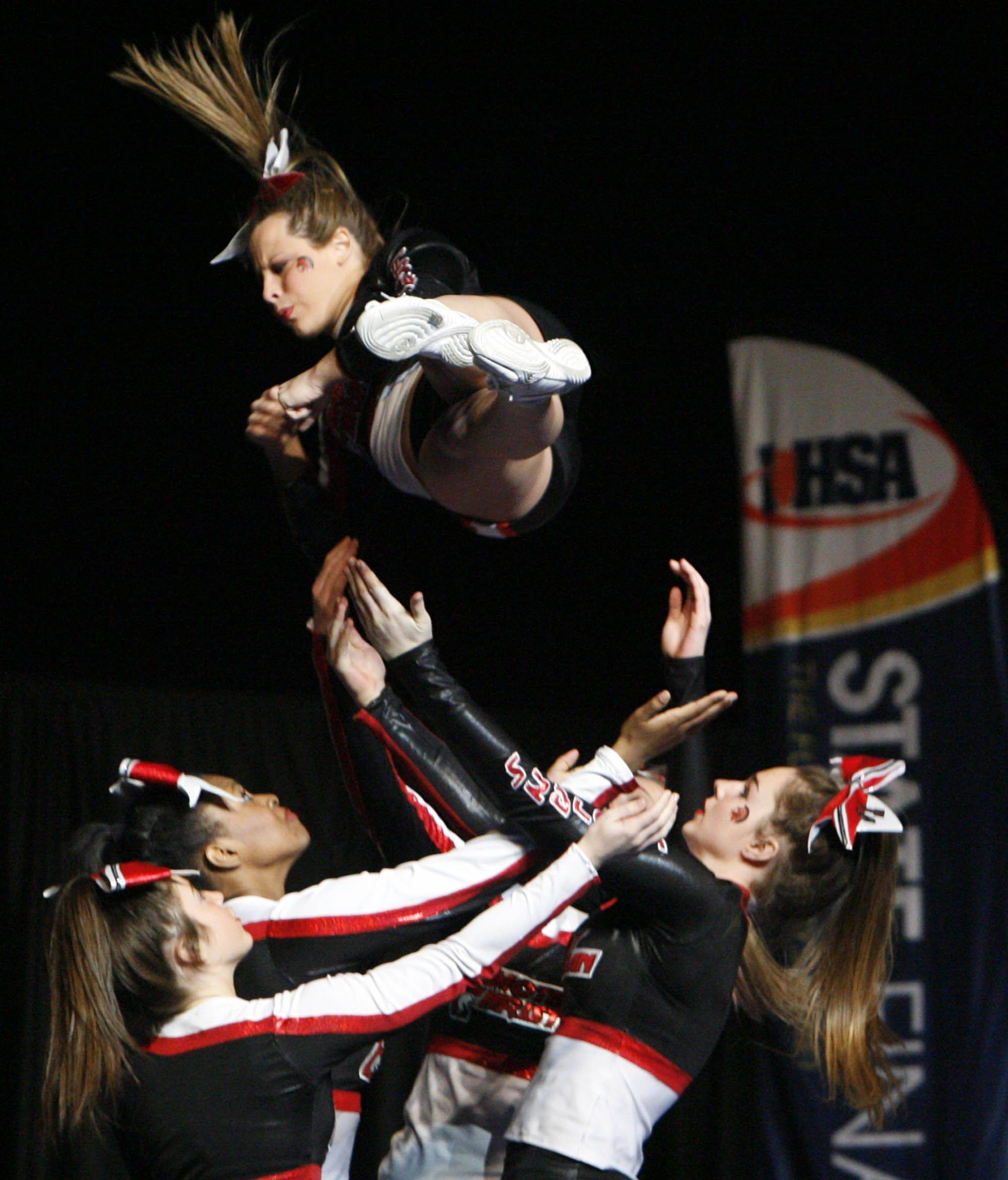 Timothy Christian competes in the small team category at IHSA cheerleading state finals at U.S. Cellular Coliseum in Bloomington on Saturday, February 4th.