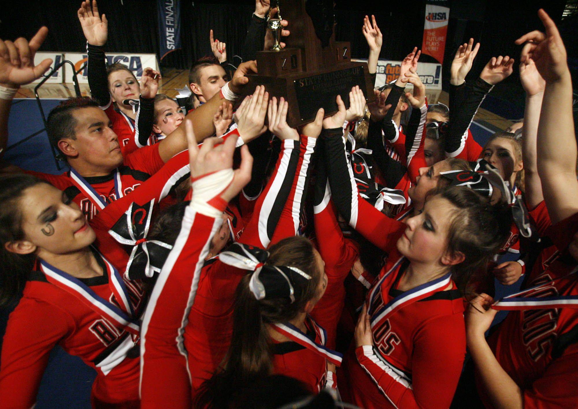 Barrington celebrates with the 2nd place trophy for the coed division at IHSA cheerleading state finals at U.S. Cellular Coliseum in Bloomington on Saturday, February 4th.