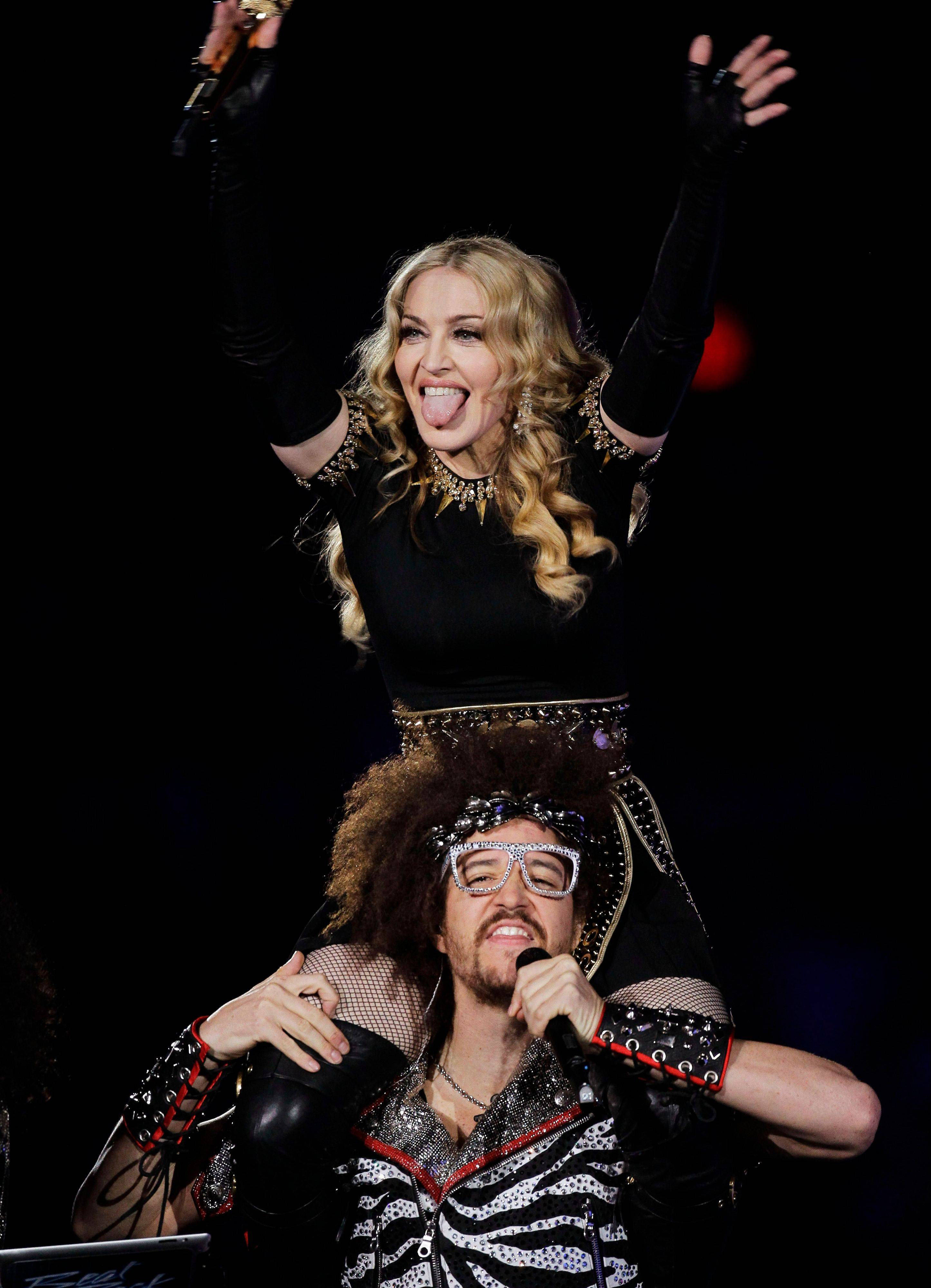 Madonna, top, performs with Redfoo, lead singer of LMFAO, during halftime show Sunday night.