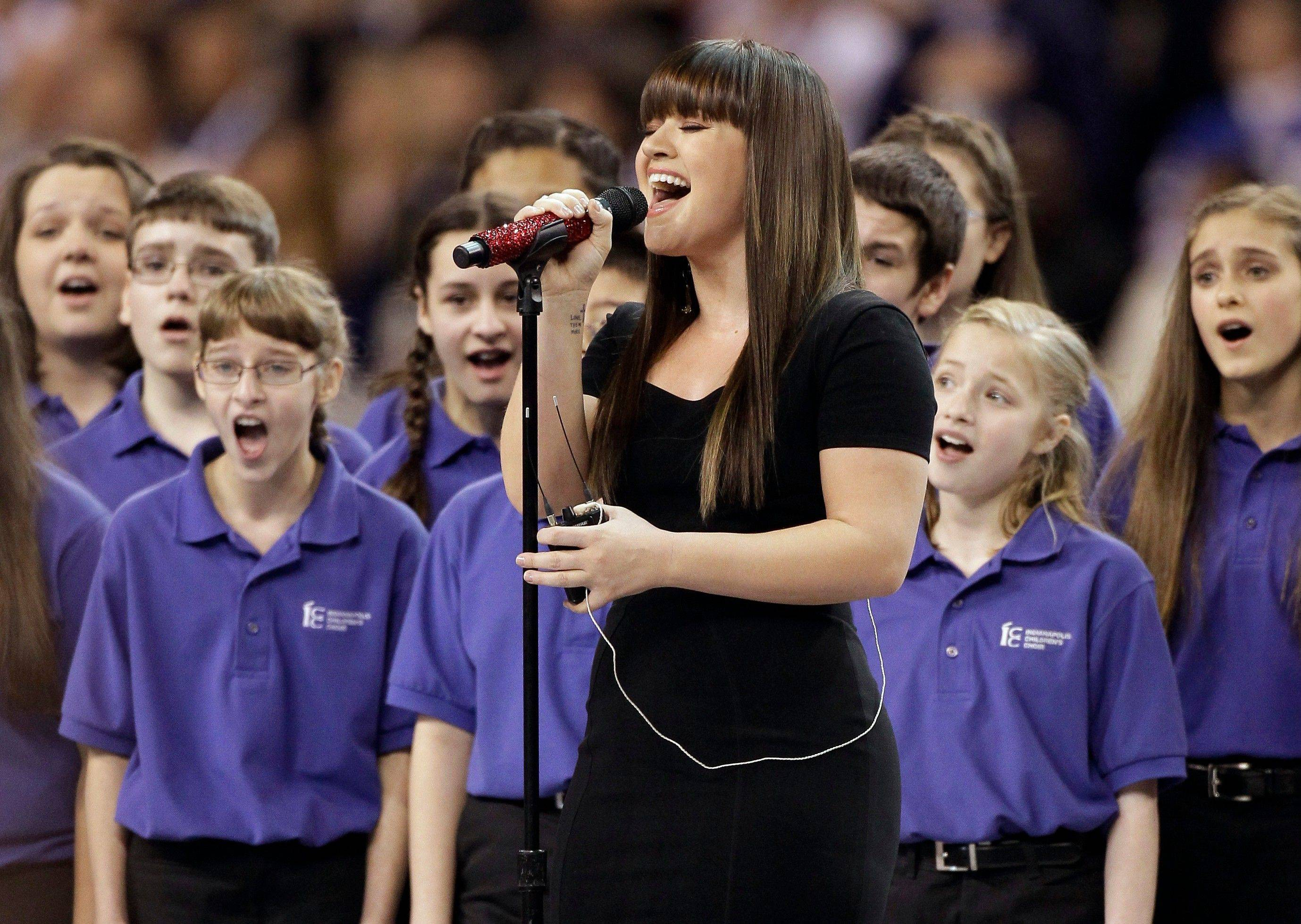 Kelly Clarkson sings the national anthem before the NFL Super Bowl XLVI football game.