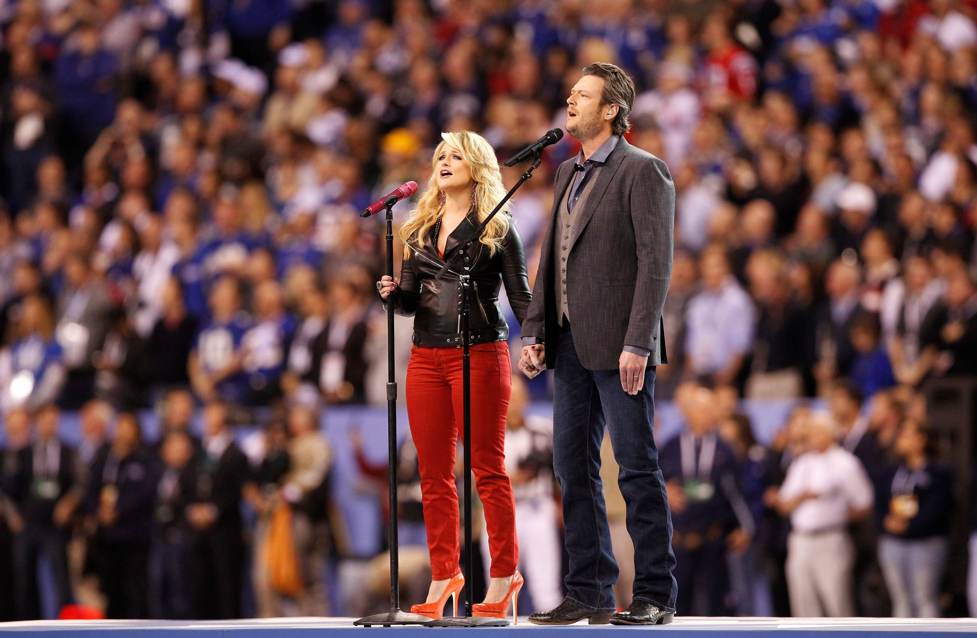 "Blake Shelton, right, and Miranda Lambert sing ""America the Beautiful"" before the NFL Super Bowl XLVI football game."
