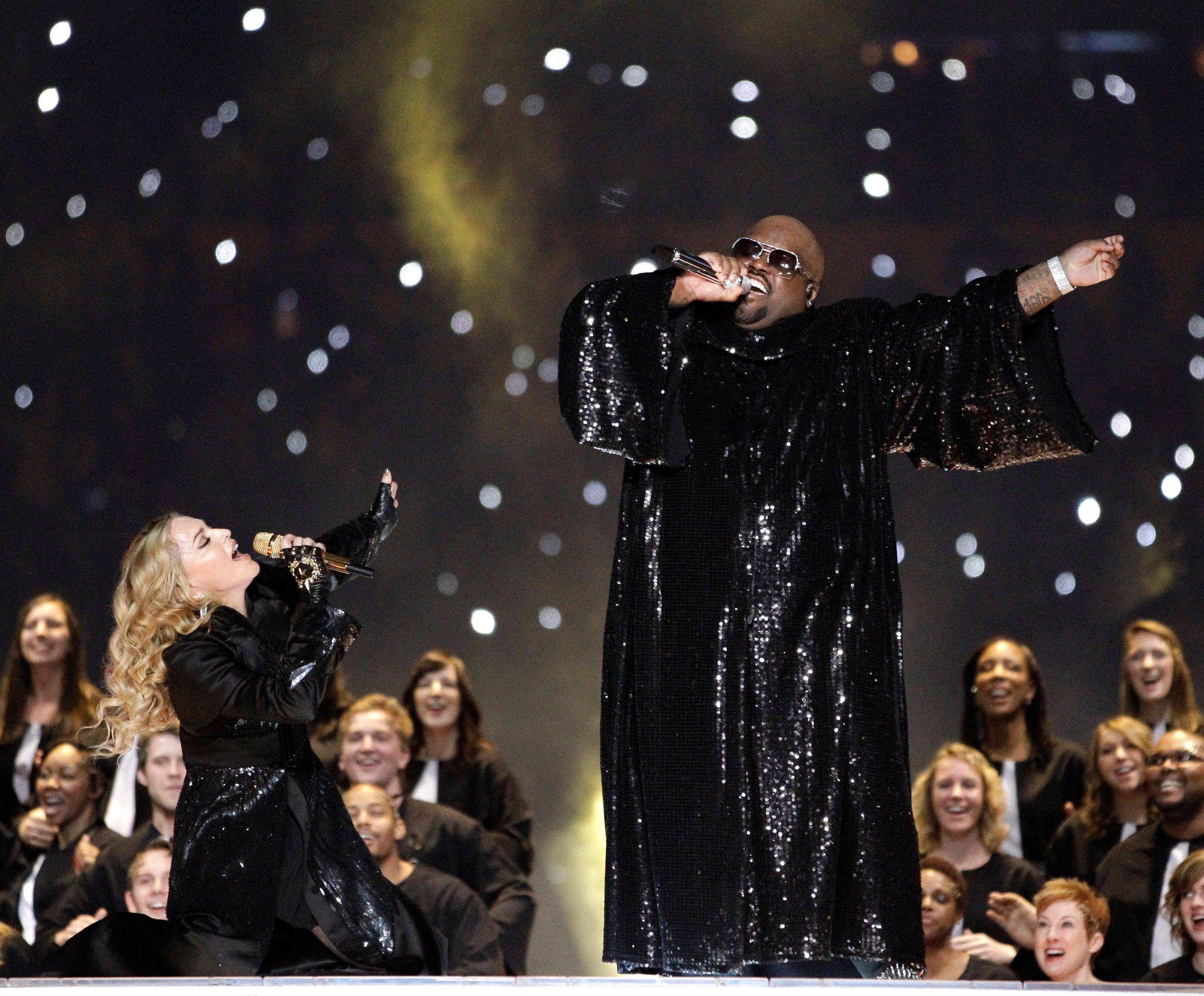 "Madonna, left, and Cee Lo Green perform ""Like a Prayer"" during the halftime show."