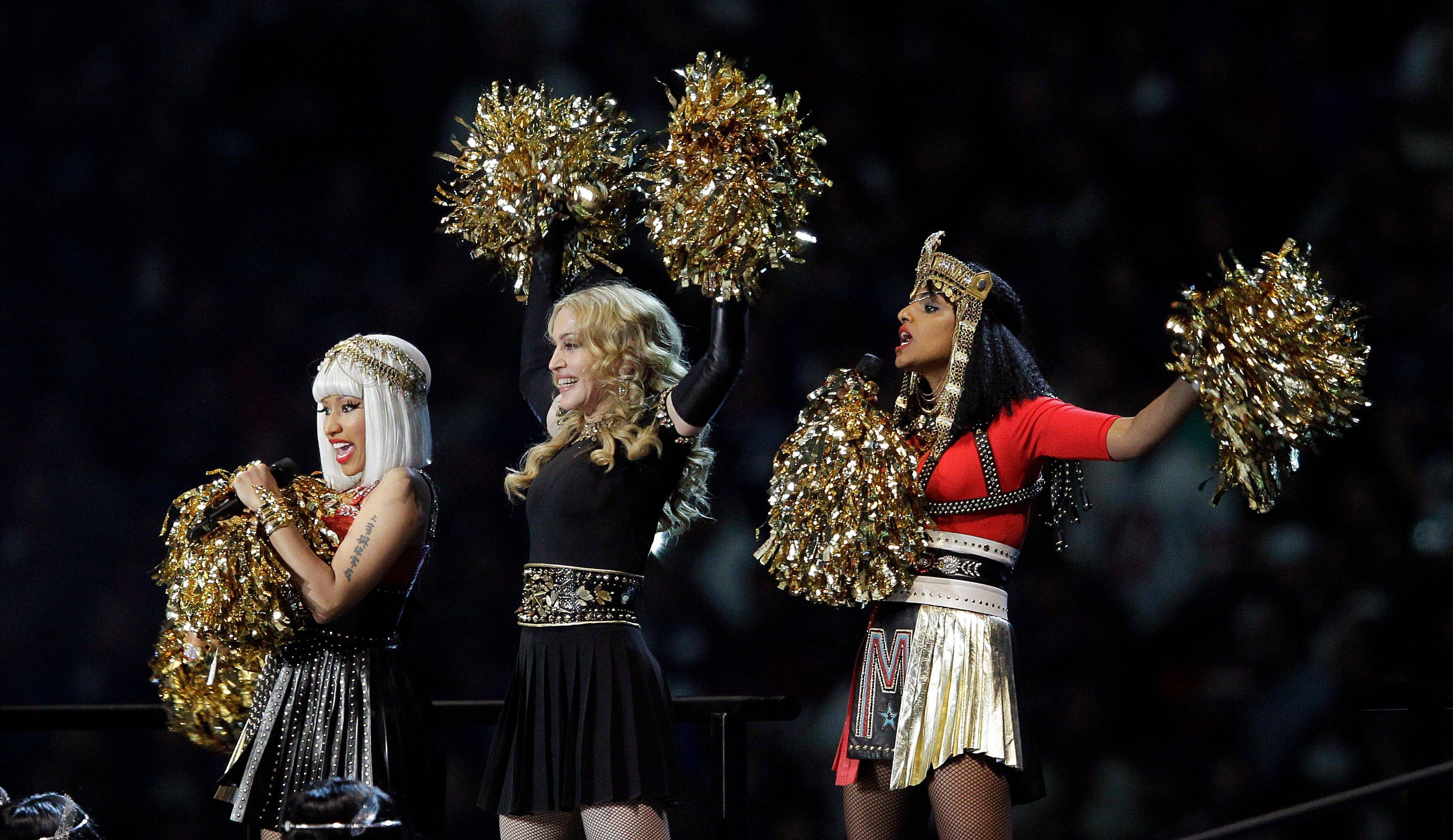 Madonna, center, performs with Nicki Minaj, left, and M.I.A. during halftime of the NFL Super Bowl XLVI football game.