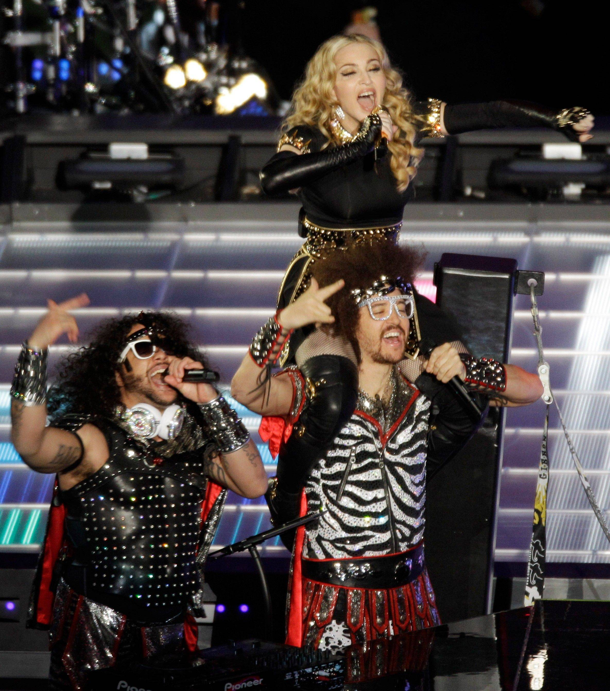Madonna performs with LMFAO during halftime of the NFL Super Bowl XLVI football game.