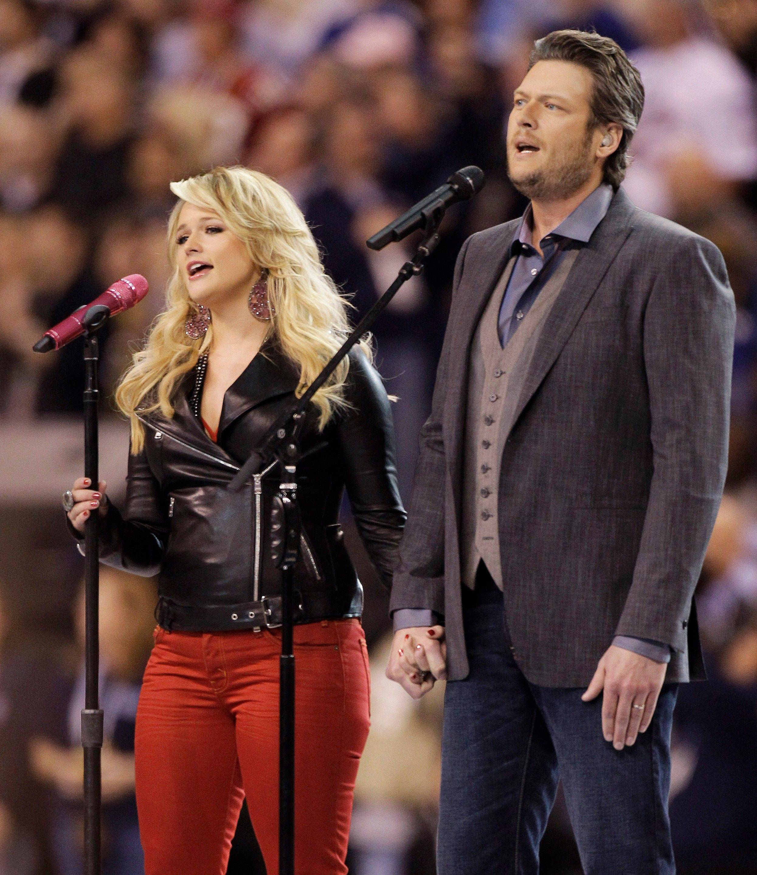 "Blake Shelton, right, and Miranda Lambert sing ""America the Beautiful"" before the NFL Super Bowl XLVI football game between the New York Giants and the New England Patriots Sunday in Indianapolis."