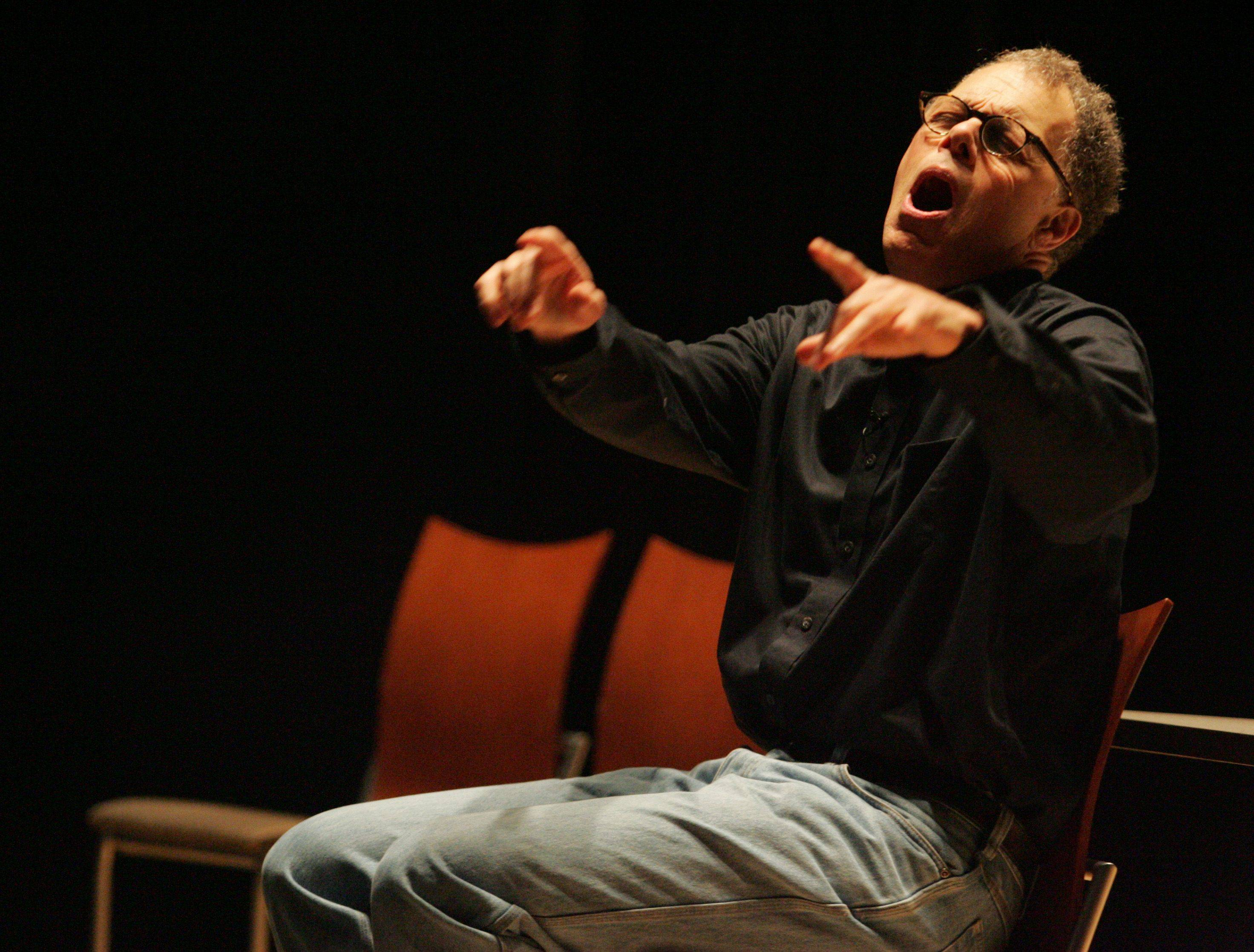 Michael Fosberg performs his one-man play for an audience at Elgin Community College.