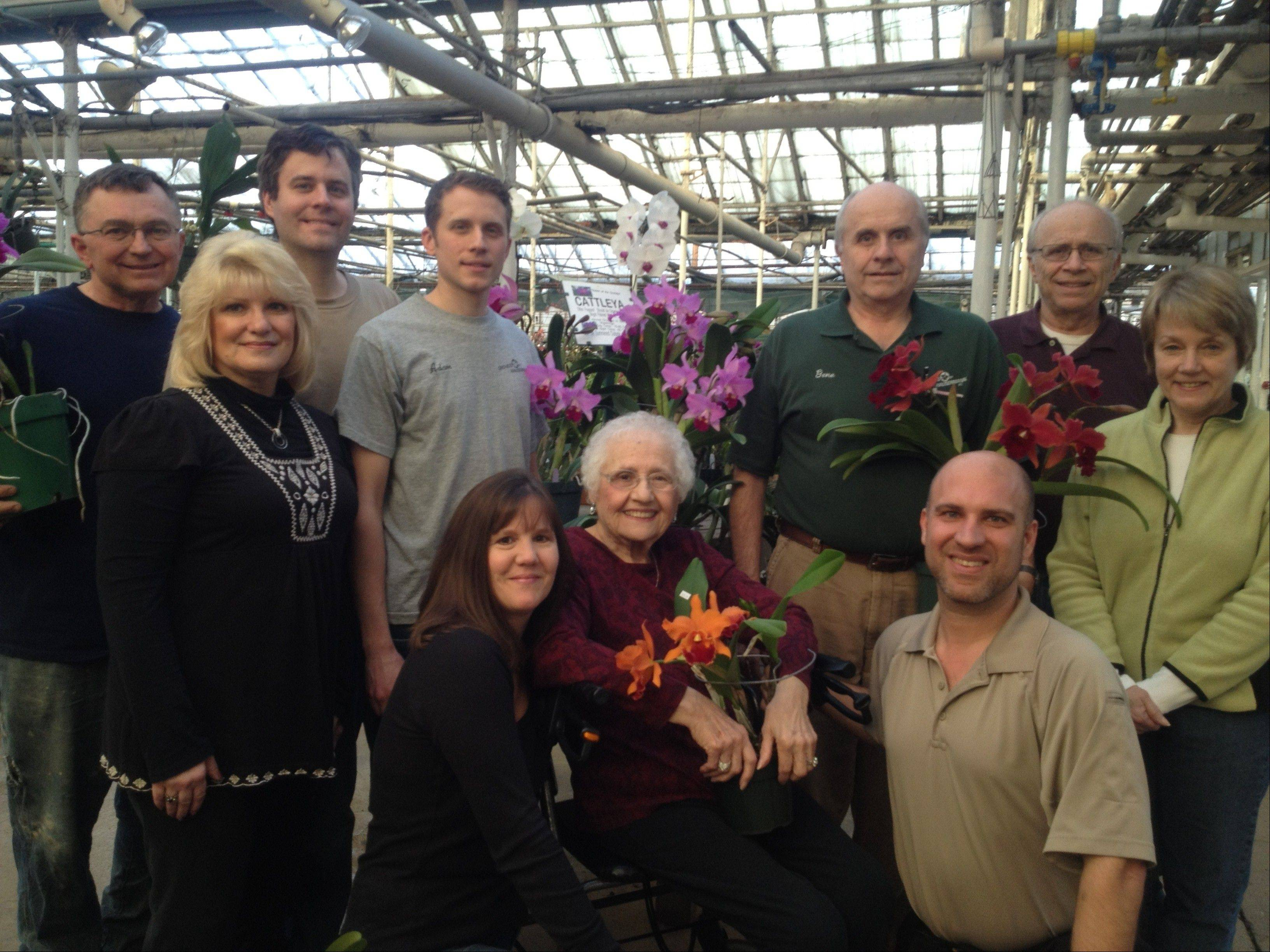 The third, fourth and fifth generation of Hausermanns are involved in running Orchids by Hausermann in Villa Park. They include, from left, Pat Funke, Melinda Funke, Andy Hausermann, Adam Hausermann, Kellie Wheeler, Irene Finney, Gene Hausermann, Bryan Wheeler, Jim Hausermann and Carol Hausermann.
