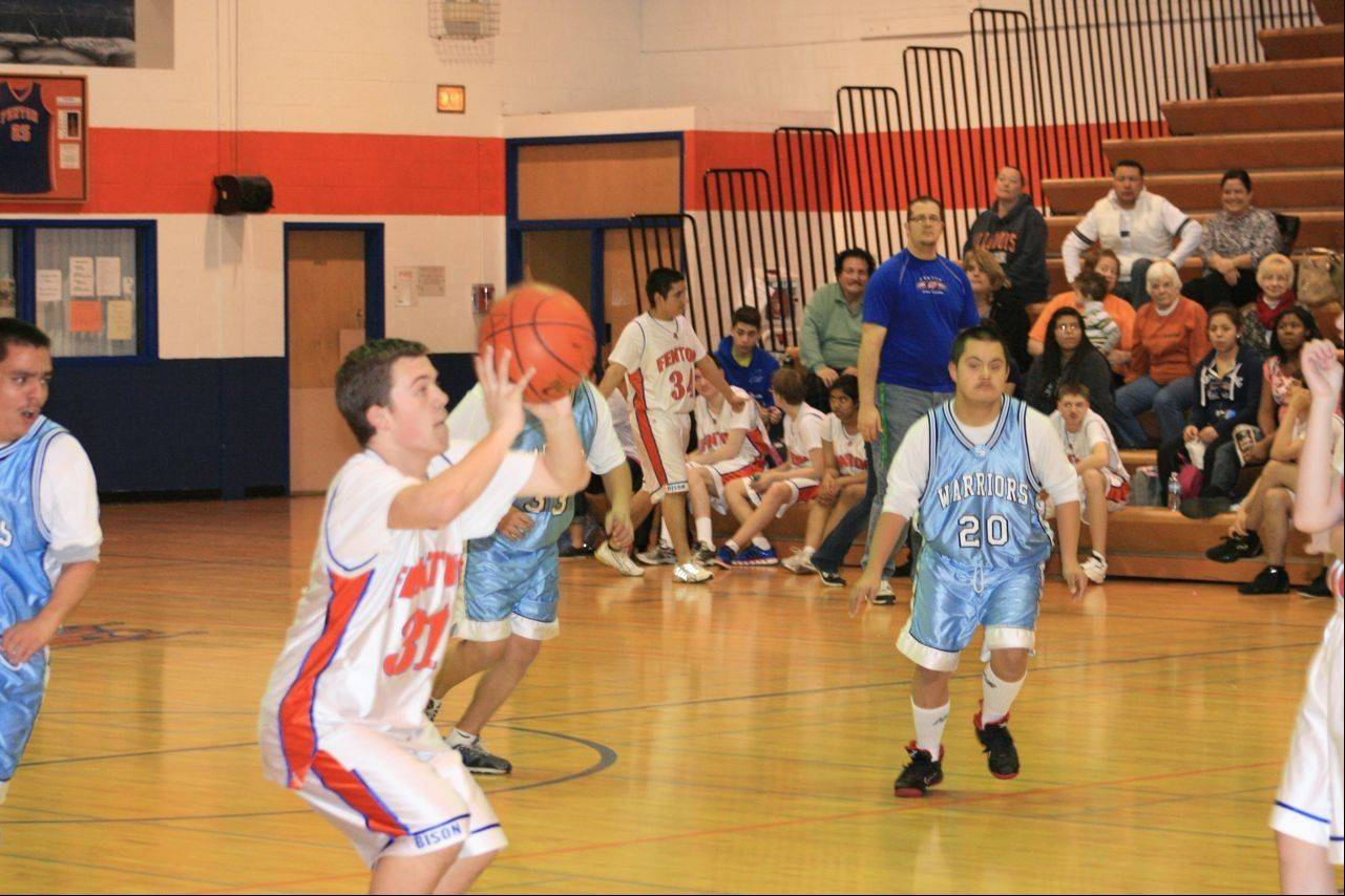 Fenton Junior Colin Staffeldt takes a shot in a game against Willowbrook High School's Special Olympics basketball team last month. Fenton's team qualified to compete at the state level in March, and the school is hosting a fundraiser game Feb. 8.