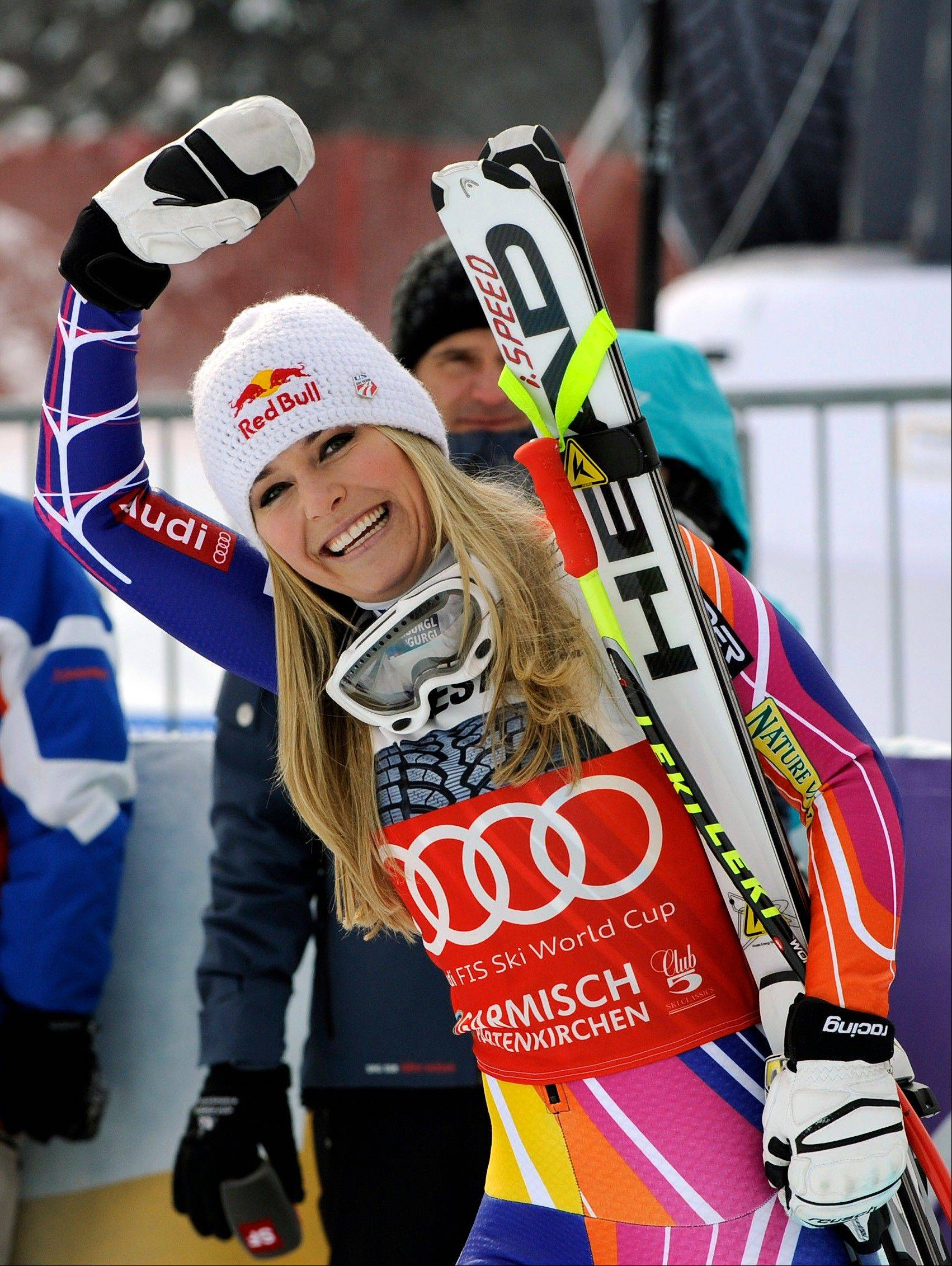 Lindsey Vonn waves as she celebrates Saturday after winning an alpine ski, women's World Cup downhill, in Garmisch-Partenkirchen, Germany. Vonn captured her 50th World Cup career victory by winning the downhill on the demanding Kandahar course on Saturday. The American is third on the all-time list, behind Annemarie Moser-Proell of Austria with 62 victories and Vreni Schneider of Switzerland with 55. Vonn now has 25 downhill wins, second behind Moser-Proell's 36.