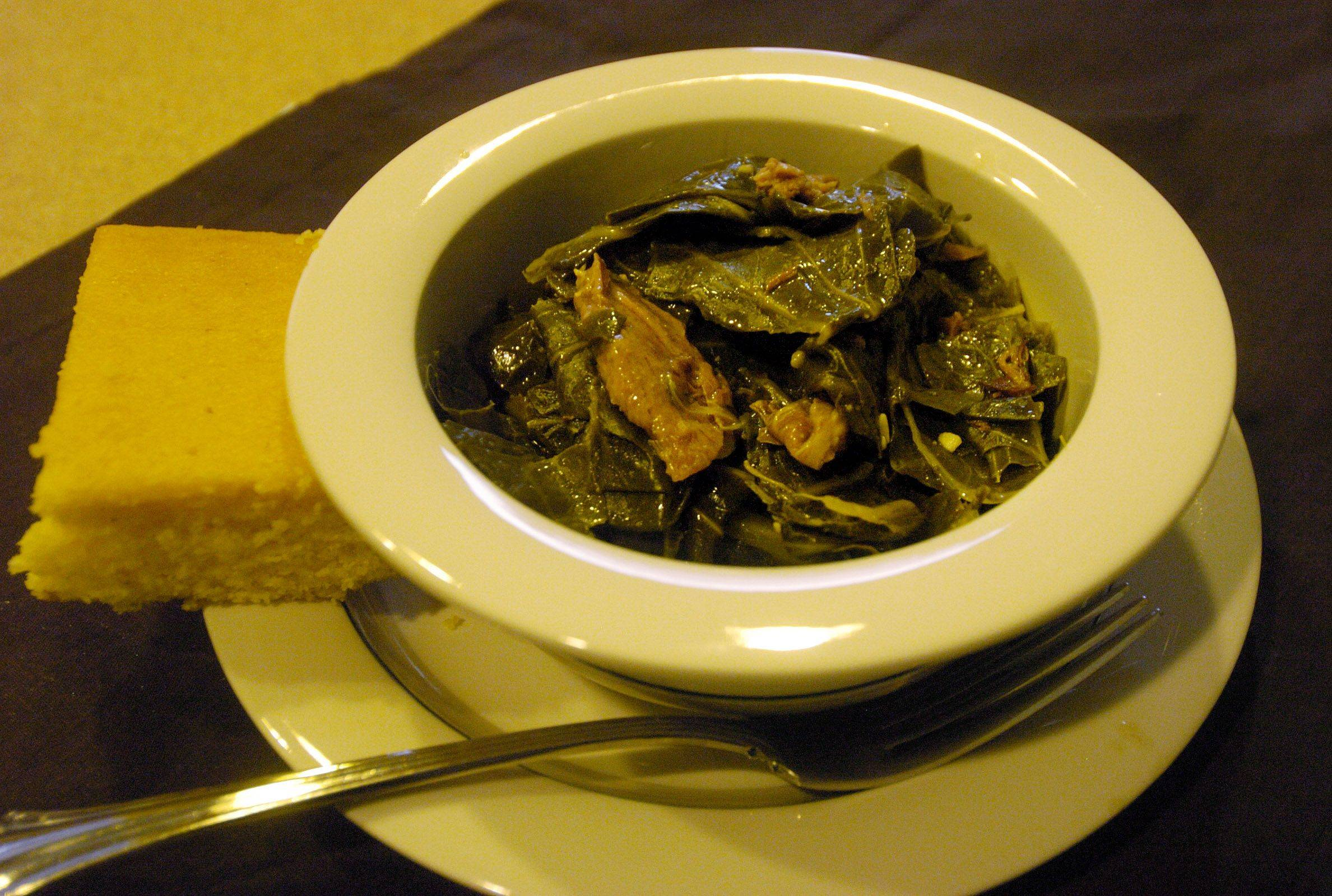 A smoked turkey leg stands in for a ham bone in this healthier take on braised collard greens.