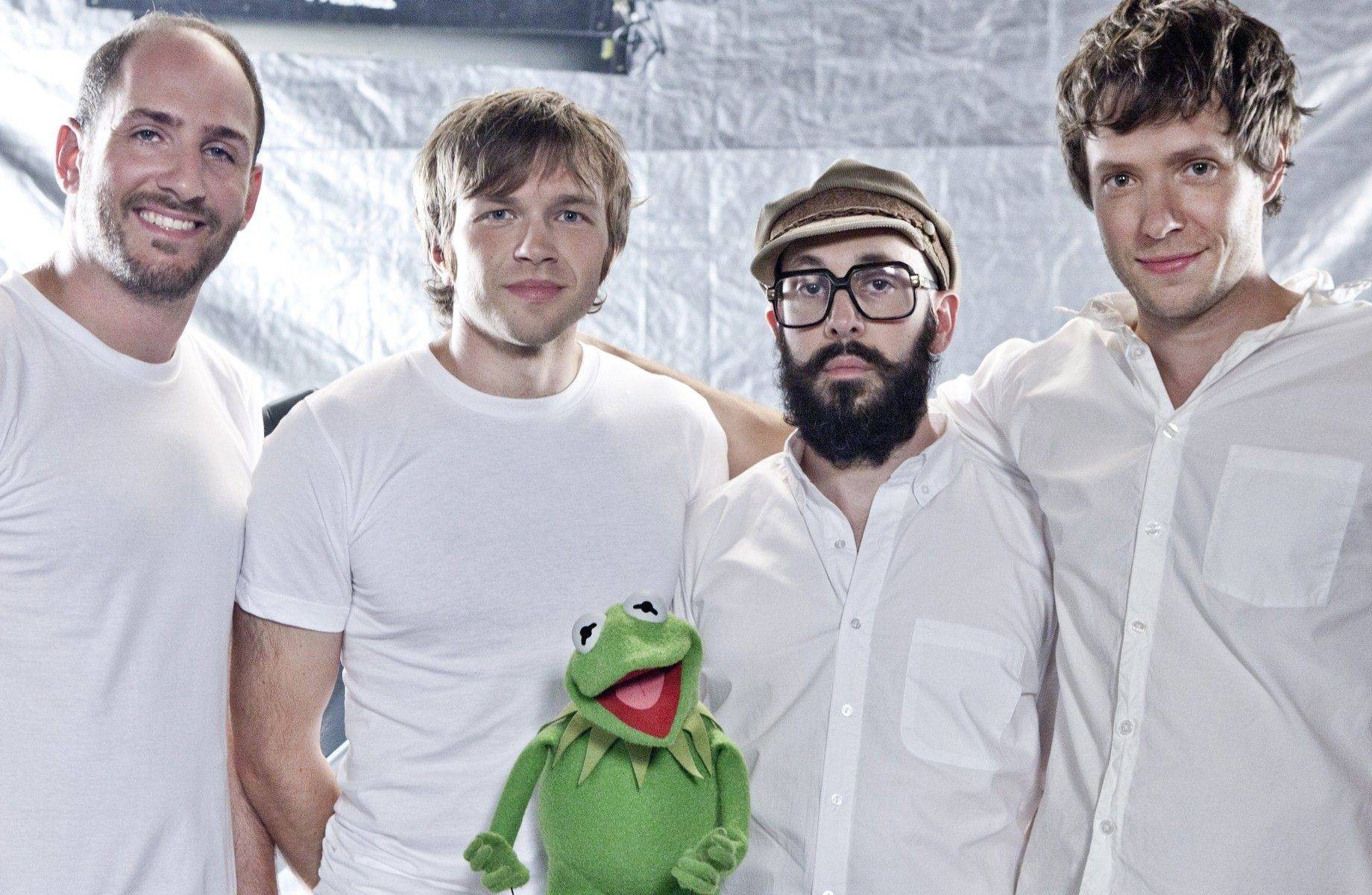 "OK GO, including its drummer, Dan Konopka of Elmhurst, left, were tapped to do an update of ""The Muppet Show"" theme song last year."