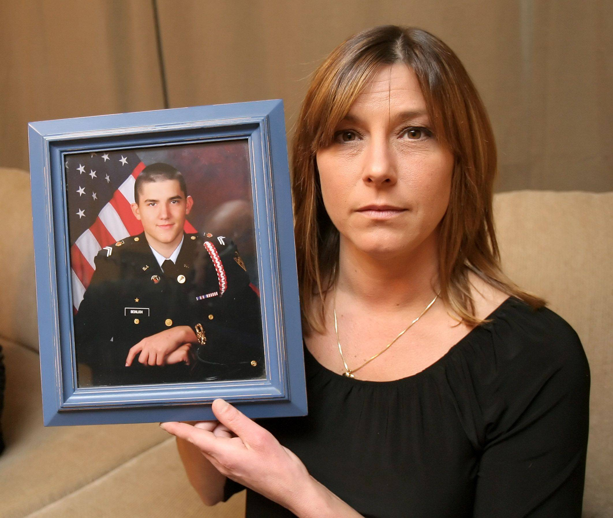 In this 2009 photo, Chrystal Beinlich O'Halloran holds a picture of her son, Nick, who she lost to a heroin overdose in 2007. It's now her mission to educate parents about drugs, and she offers free drug testing kits through a foundation in her son's memory at nickbeinlich.com.