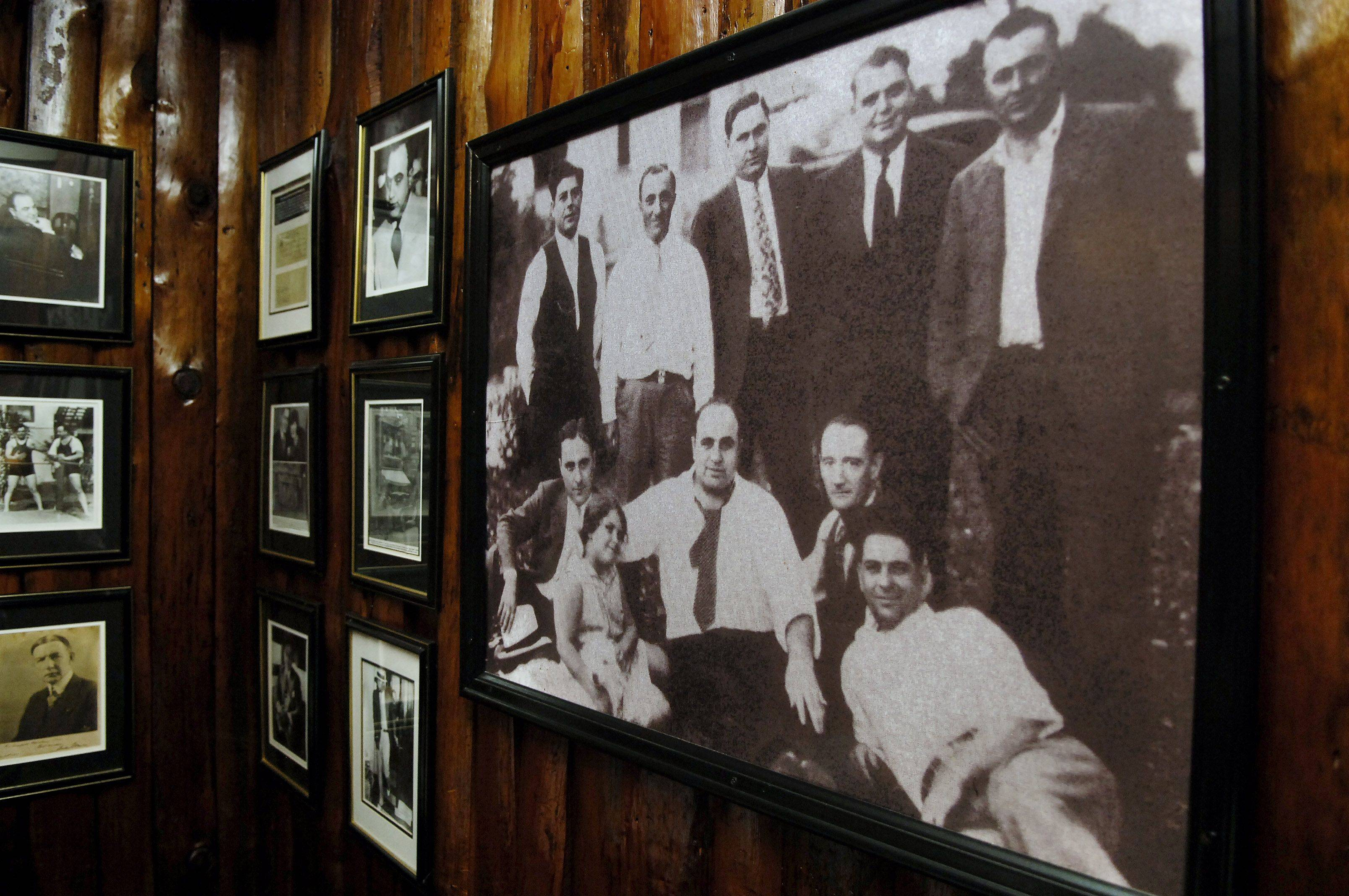 LAURA STOECKER/lstoecker@dailyherald.comOld photos and newspaper articles decorate the walls at Al Capone's Hideaway.