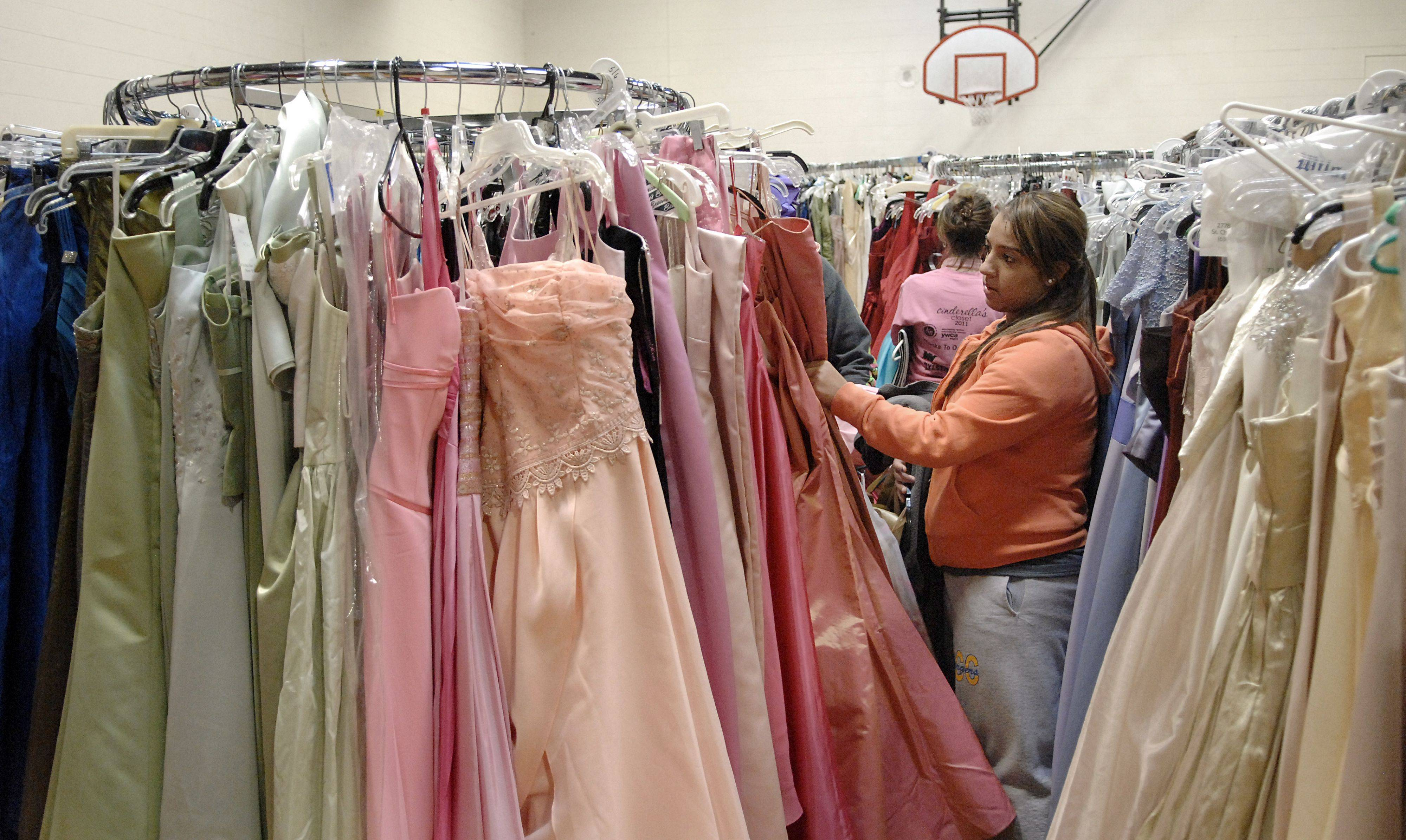 Laura Stoecker/lstoecker@dailyherald.com, 2011 Alyssa Fonseca, 18, of Aurora looks through dresses at last year's Cinderella's Closet at the YWCA in Elgin. Fonseca, a student at Aurora Central Catholic, was helping a friend find a dress. The Elgin Junior Service Board sponsors the formal wear boutique where high school students can shop for dresses, purses, and more for their prom, all for a $5 donation with 100 percent going to support the YWCA Elgin's educational programs. This year's event is set for March 17.