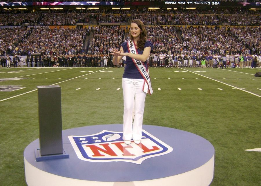 "Rachel Mazique performs in sign-language ""America the Beautiful"" during Super Bowl XLVI at Lucas Oil Stadium in Indianapolis as Blake Shelton and Miranda Lambert performed the English version."