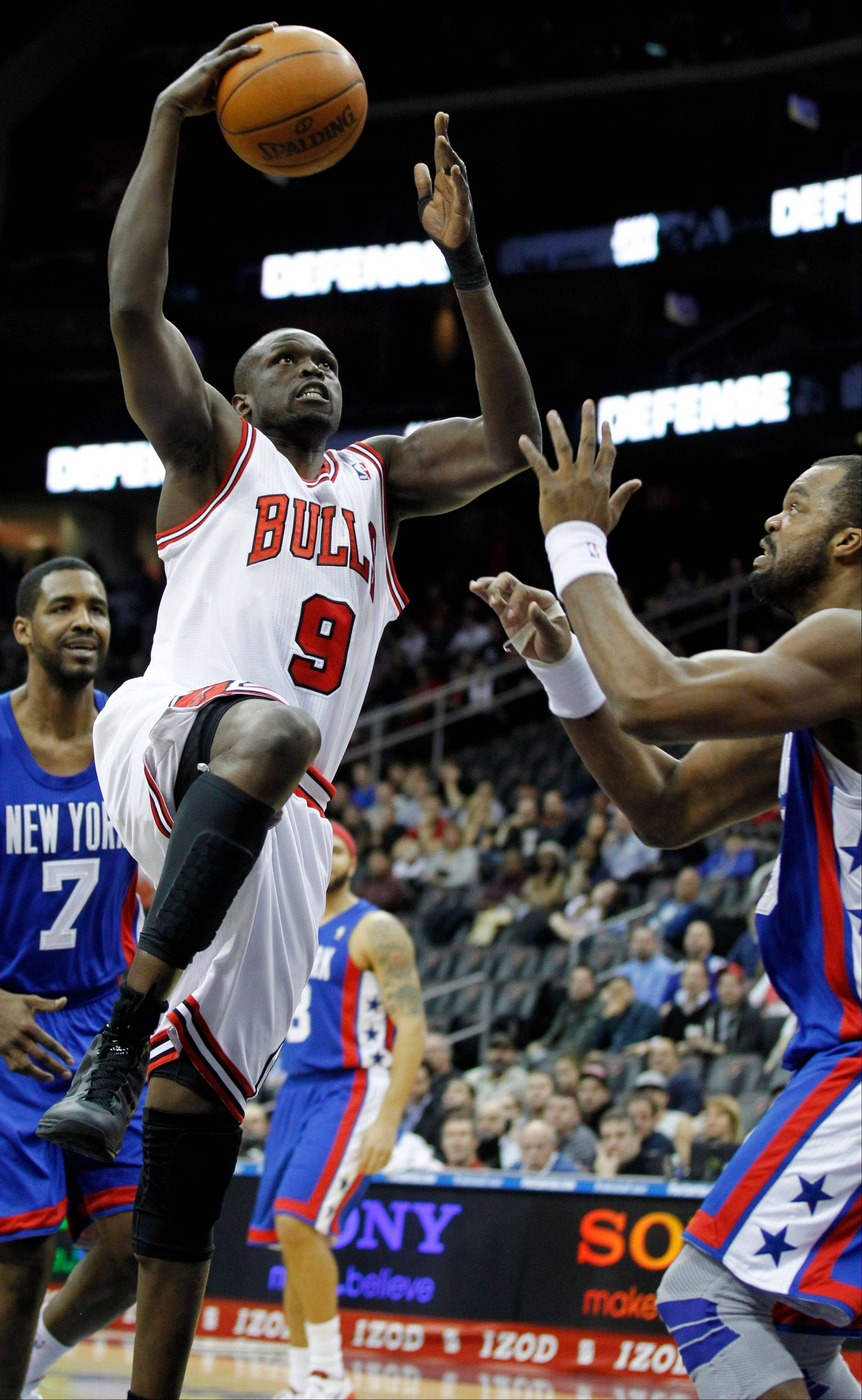 The Bulls' Luol Deng goes up for a shot against the Nets' Shelden Williams during the first quarter Monday night.