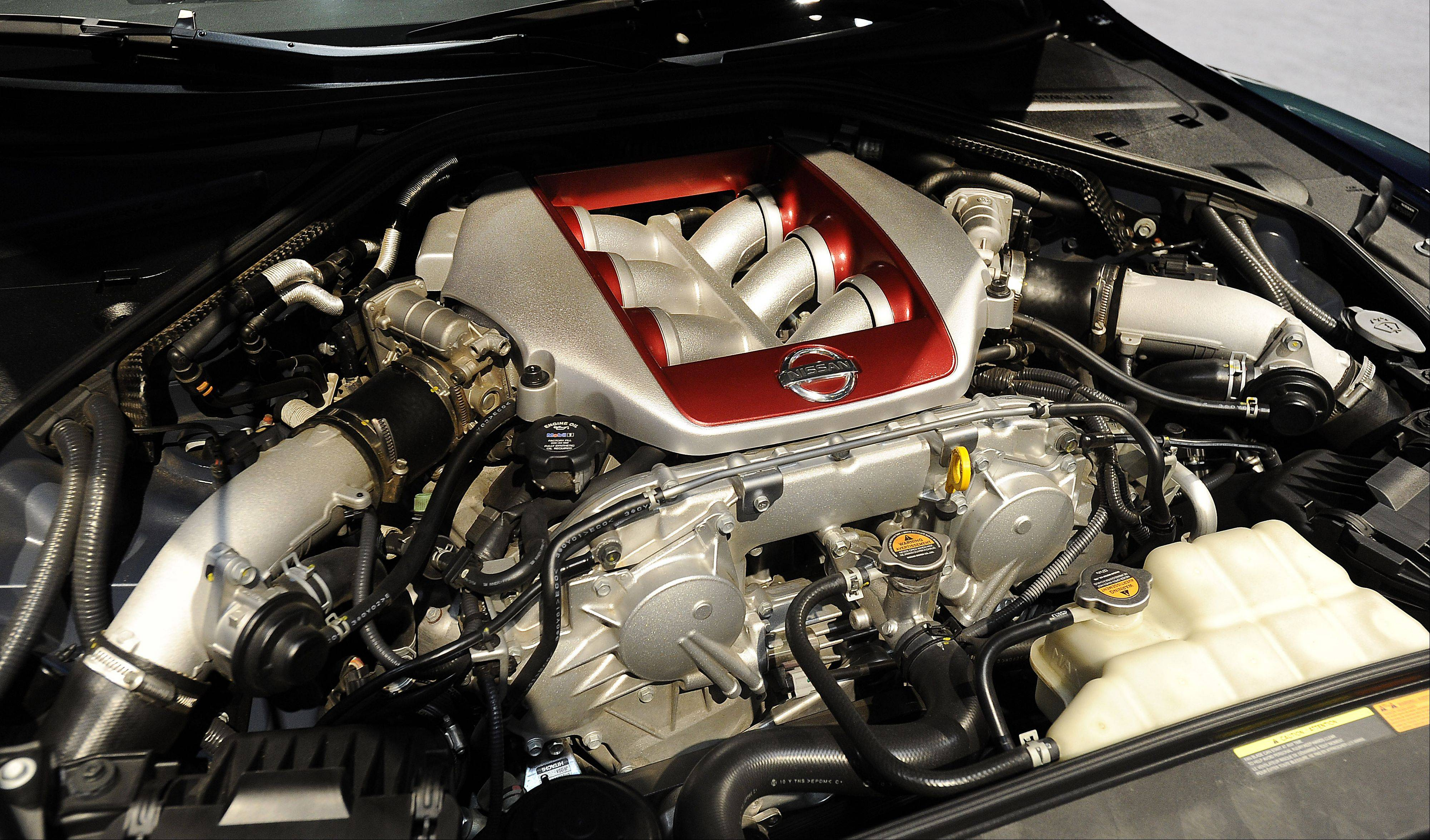 The engine of the Nissan GTR is on display.