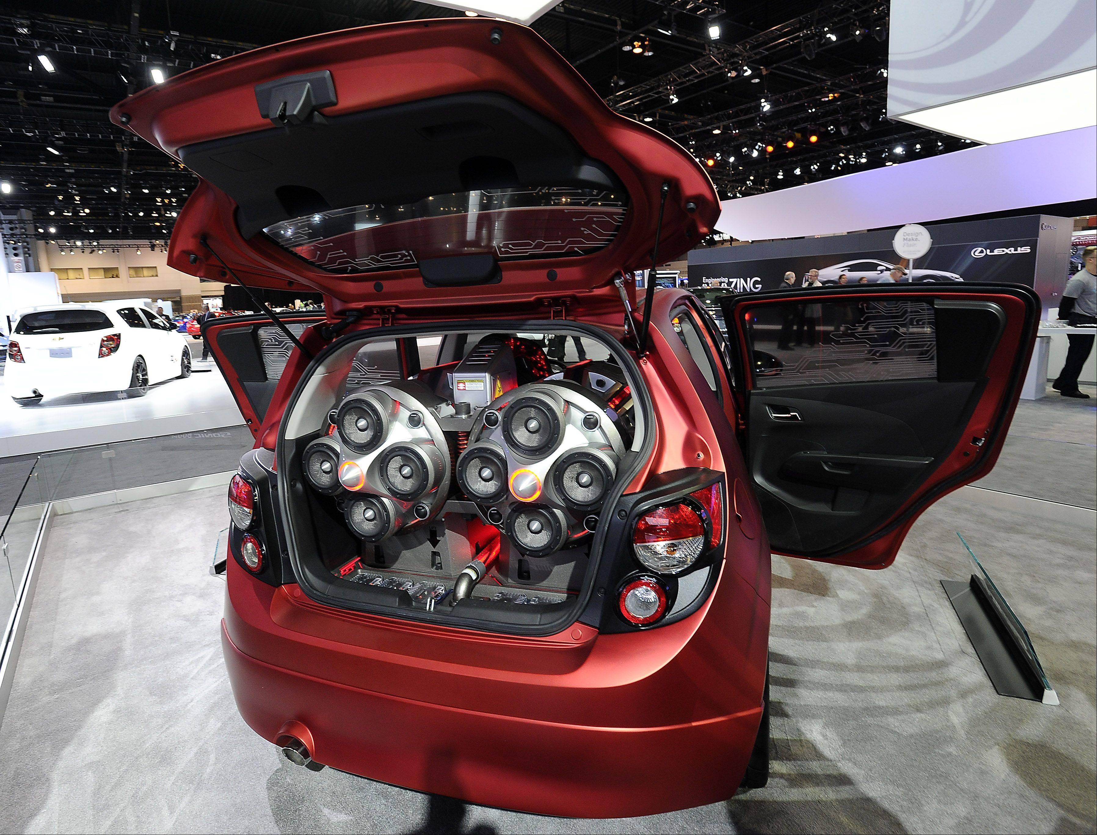 The Chevy Sonic Boom concept features speakers in the back and is displayed at the Chicago Auto Show .