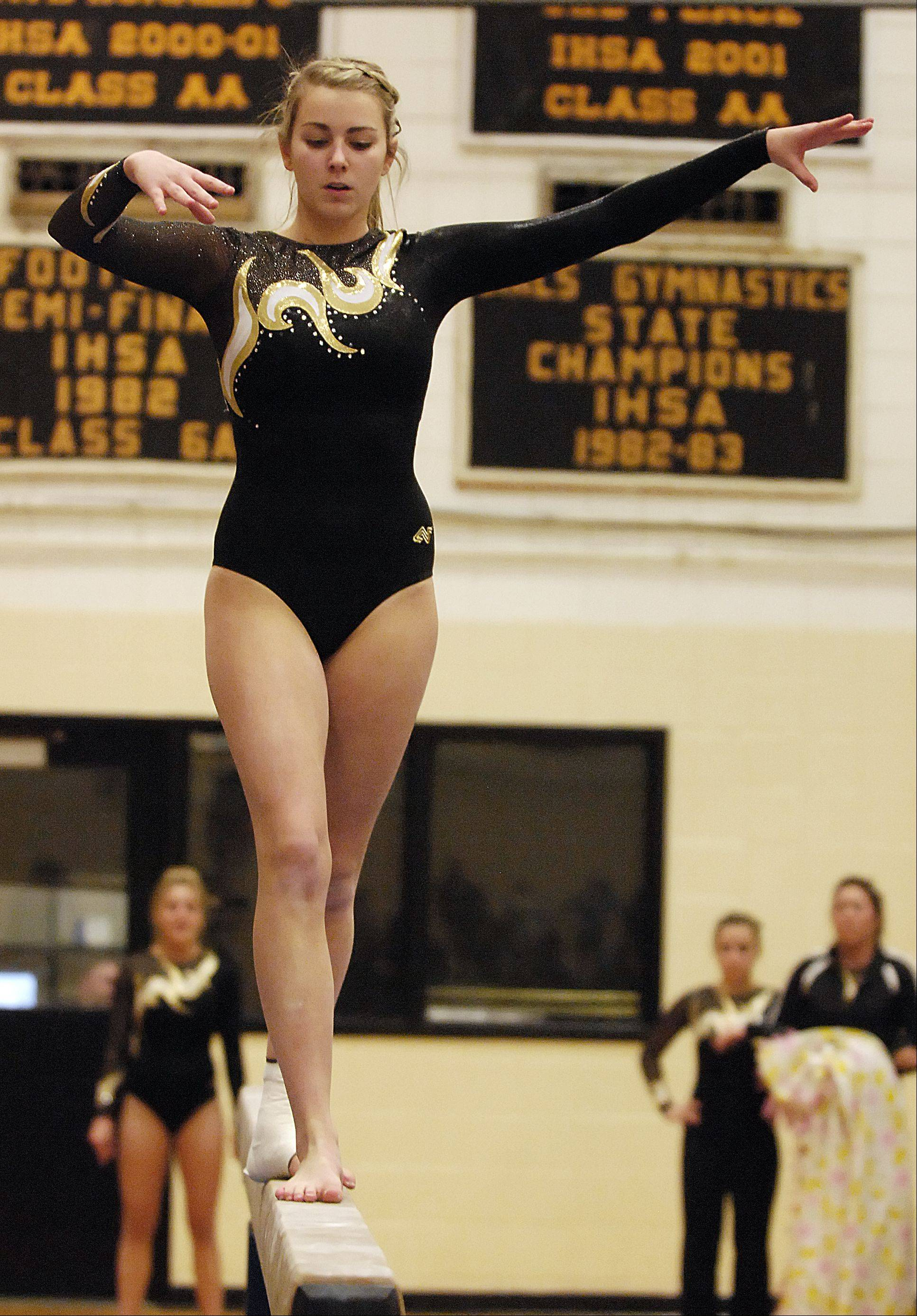 Erin Panhorst of Glenbard North performs on the beam during the girls gymnastics gectional tournament at Glenbard North High School.